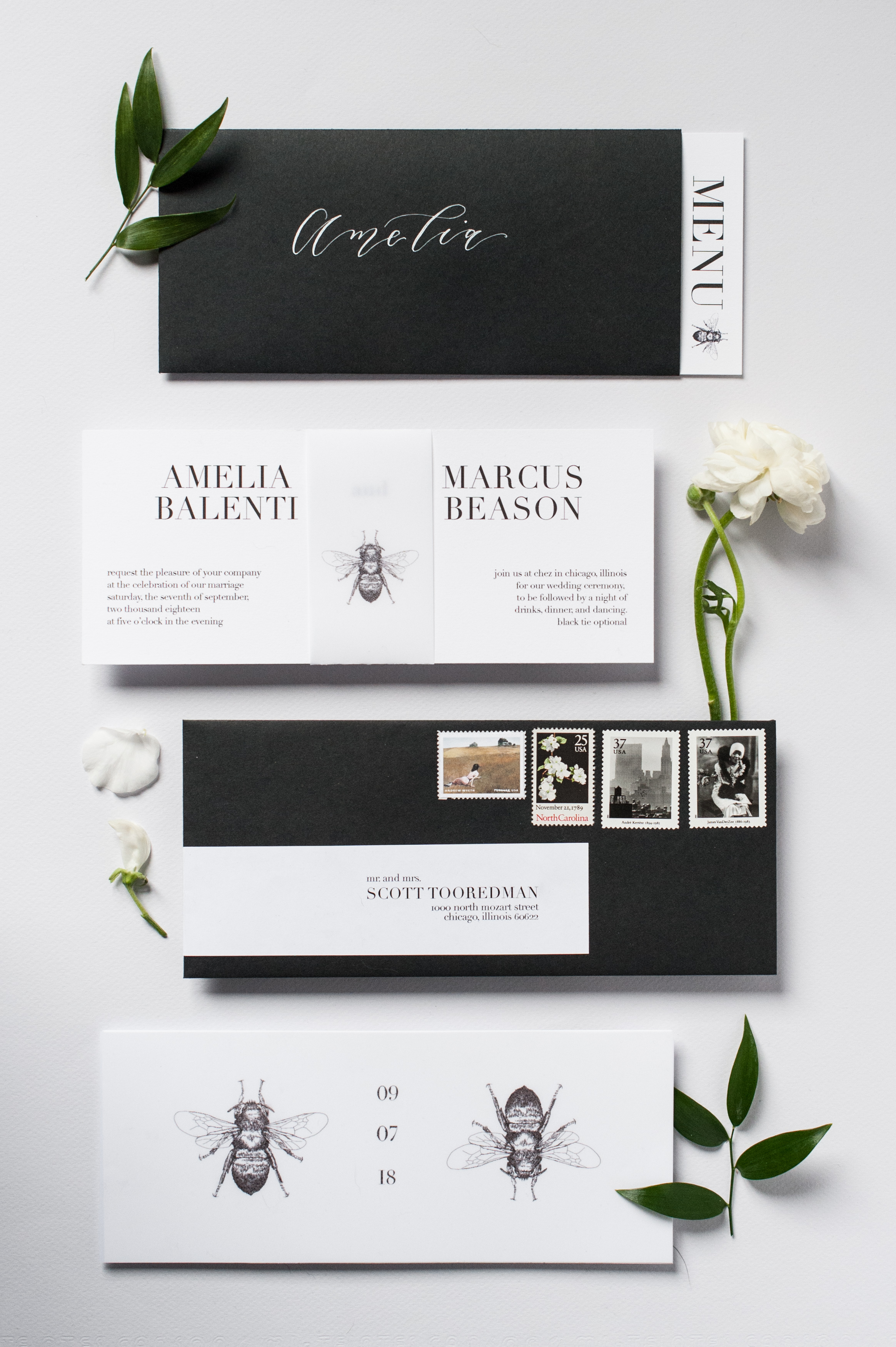 black and white wedding invitation with envelope