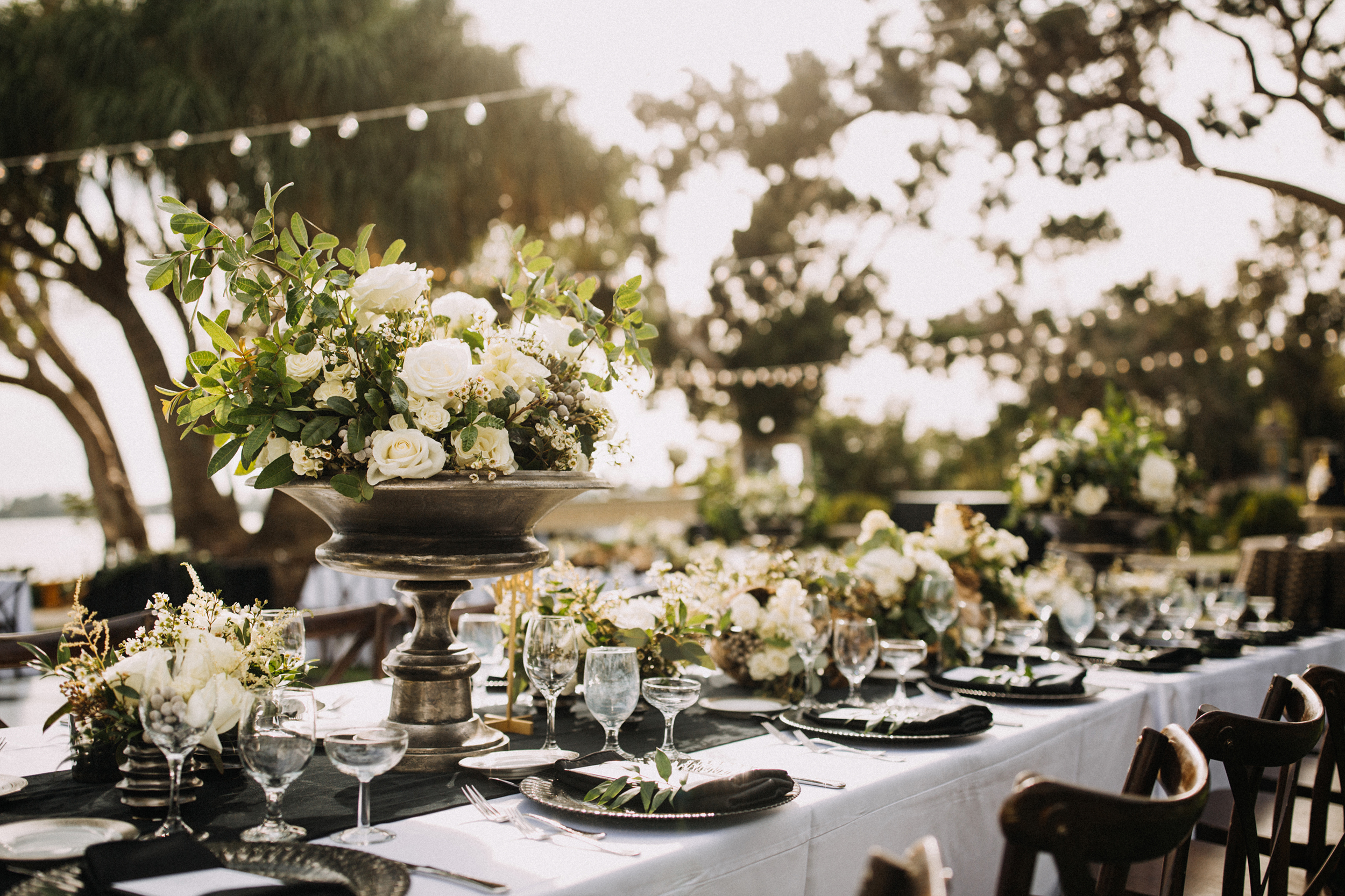 black white table with floral centerpiece
