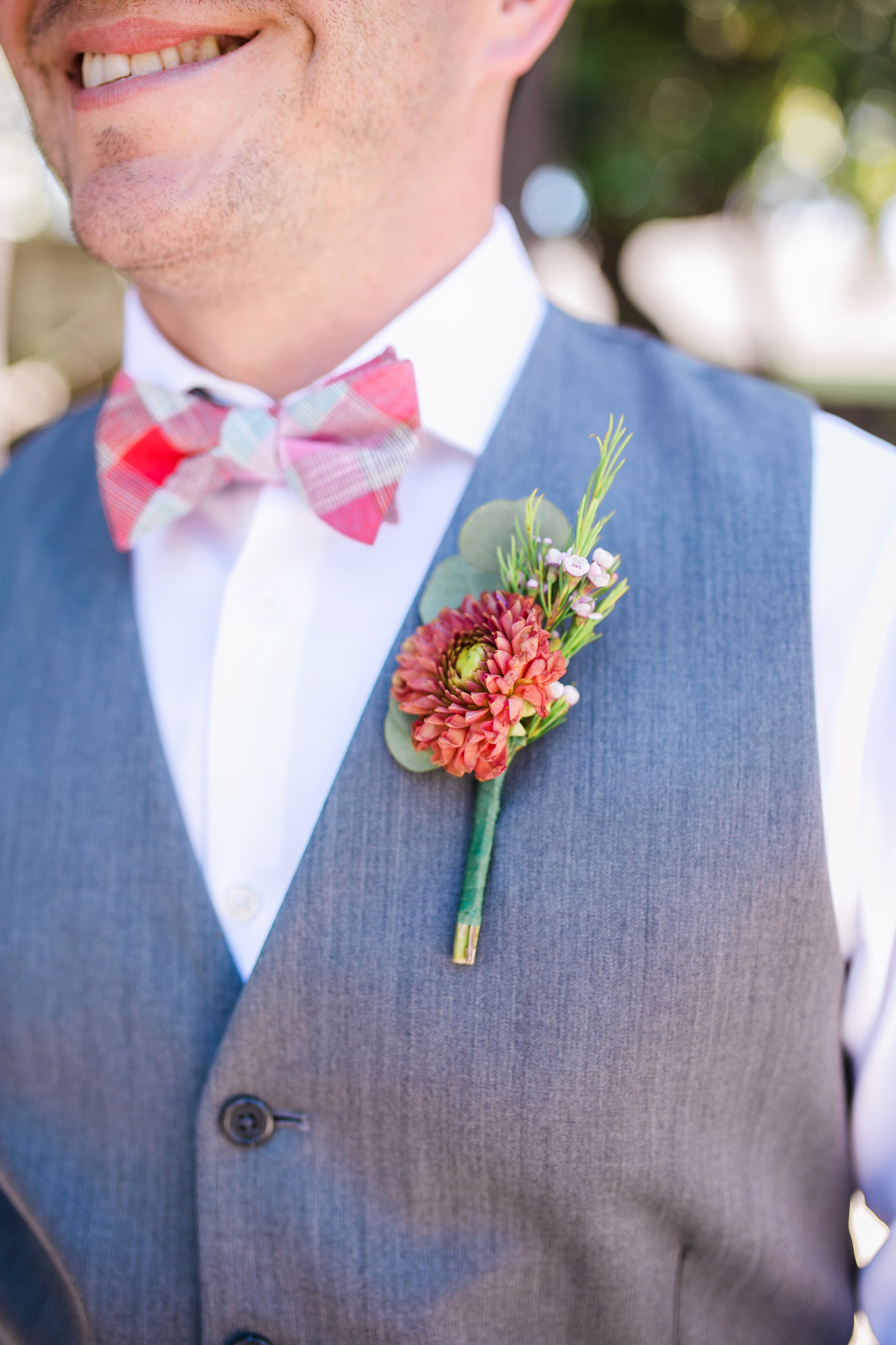 red flower boutonniere