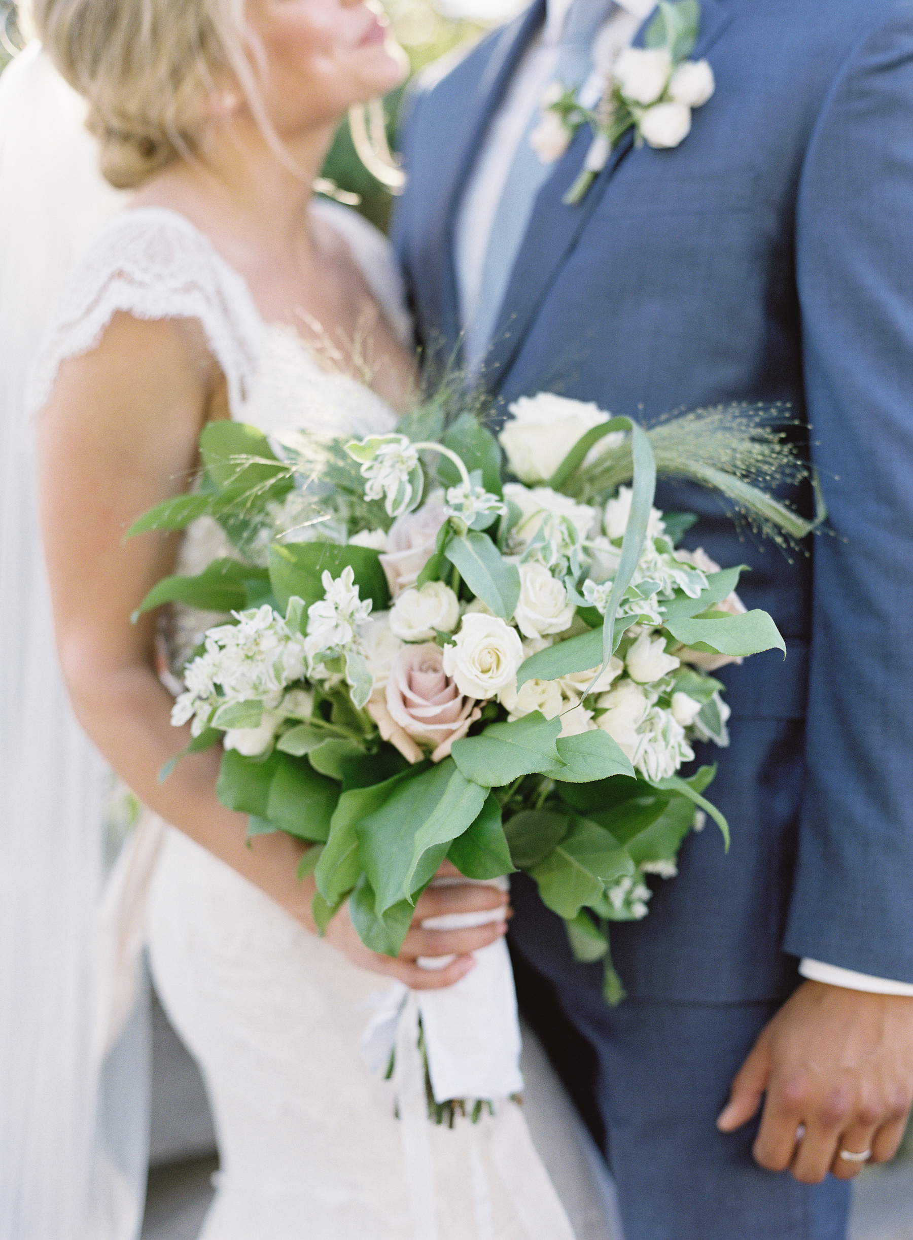 bride and groom with bouquet
