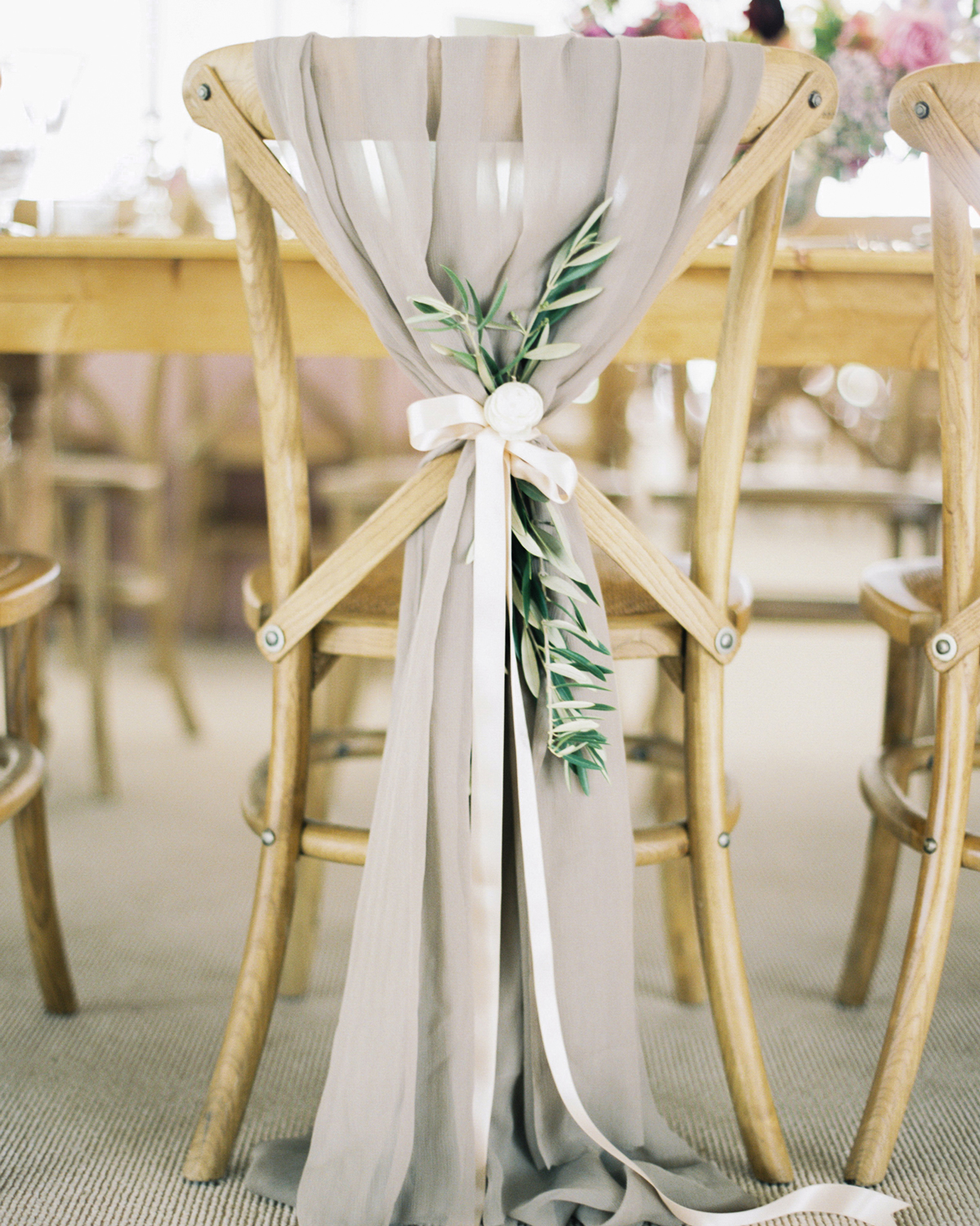 ribbon wedding ideas table cloth tied with satin ribbon to reception chair backs