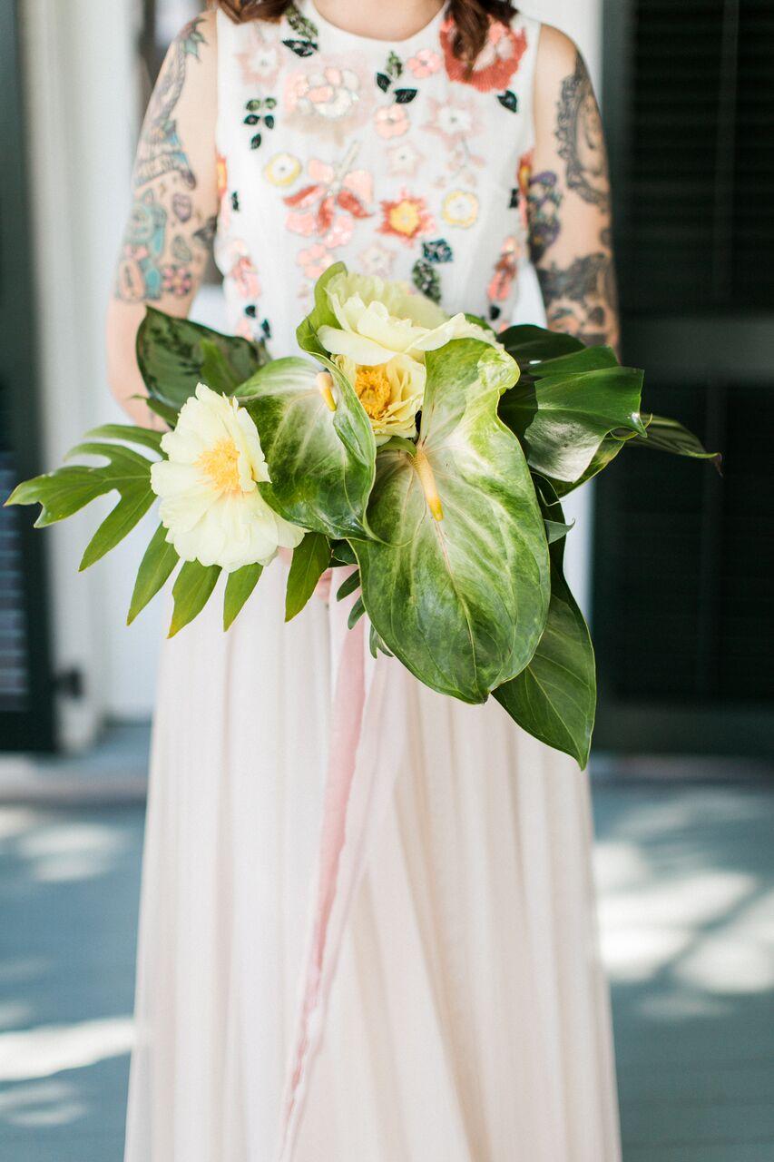 bride with unconventional bouquet