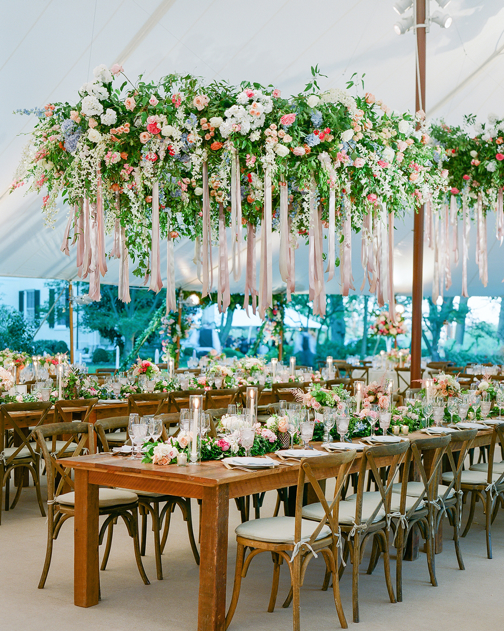 ribbon wedding ideas flowers and ribbon hanging above reception tables
