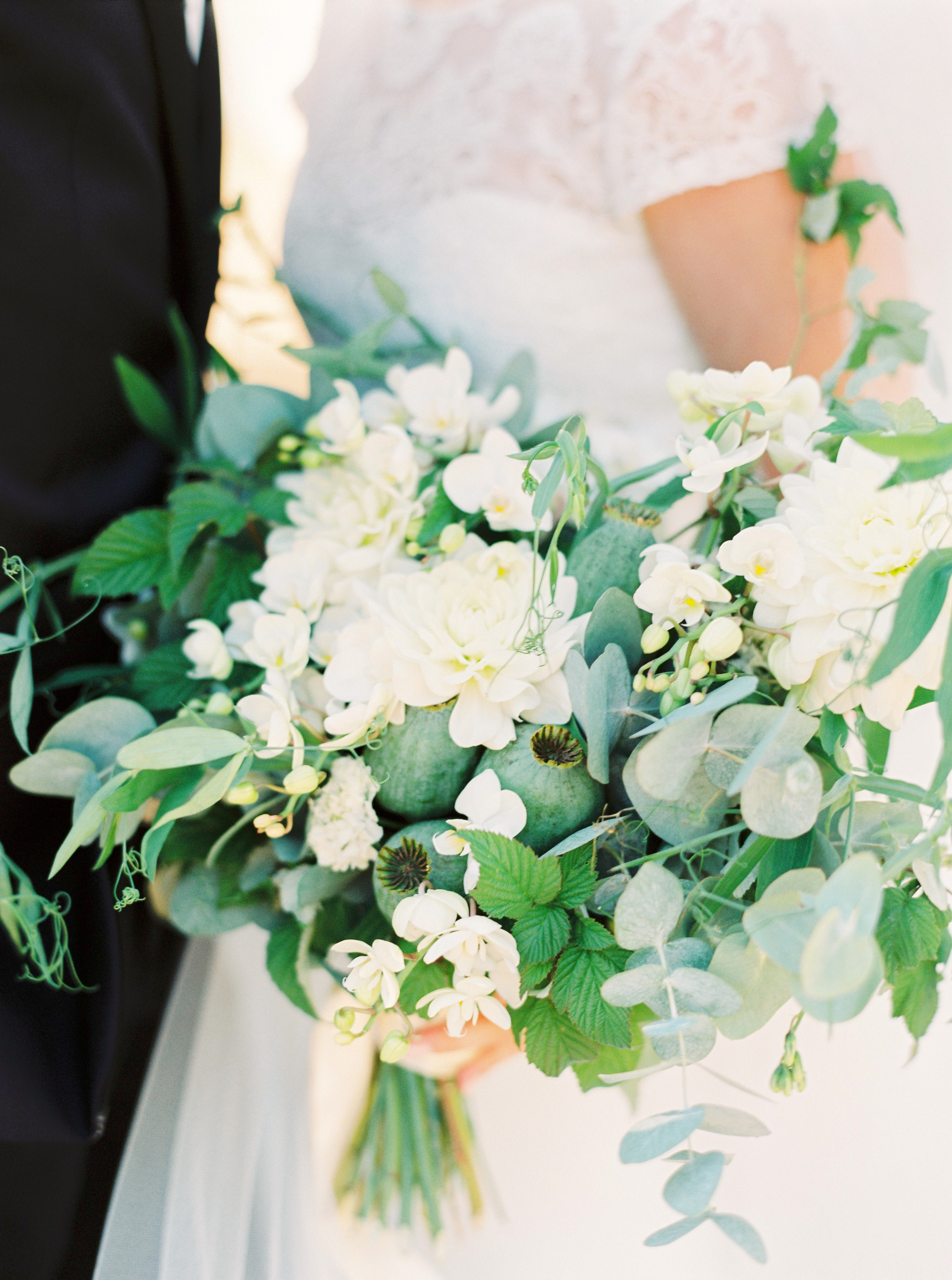 couple with white bouquet