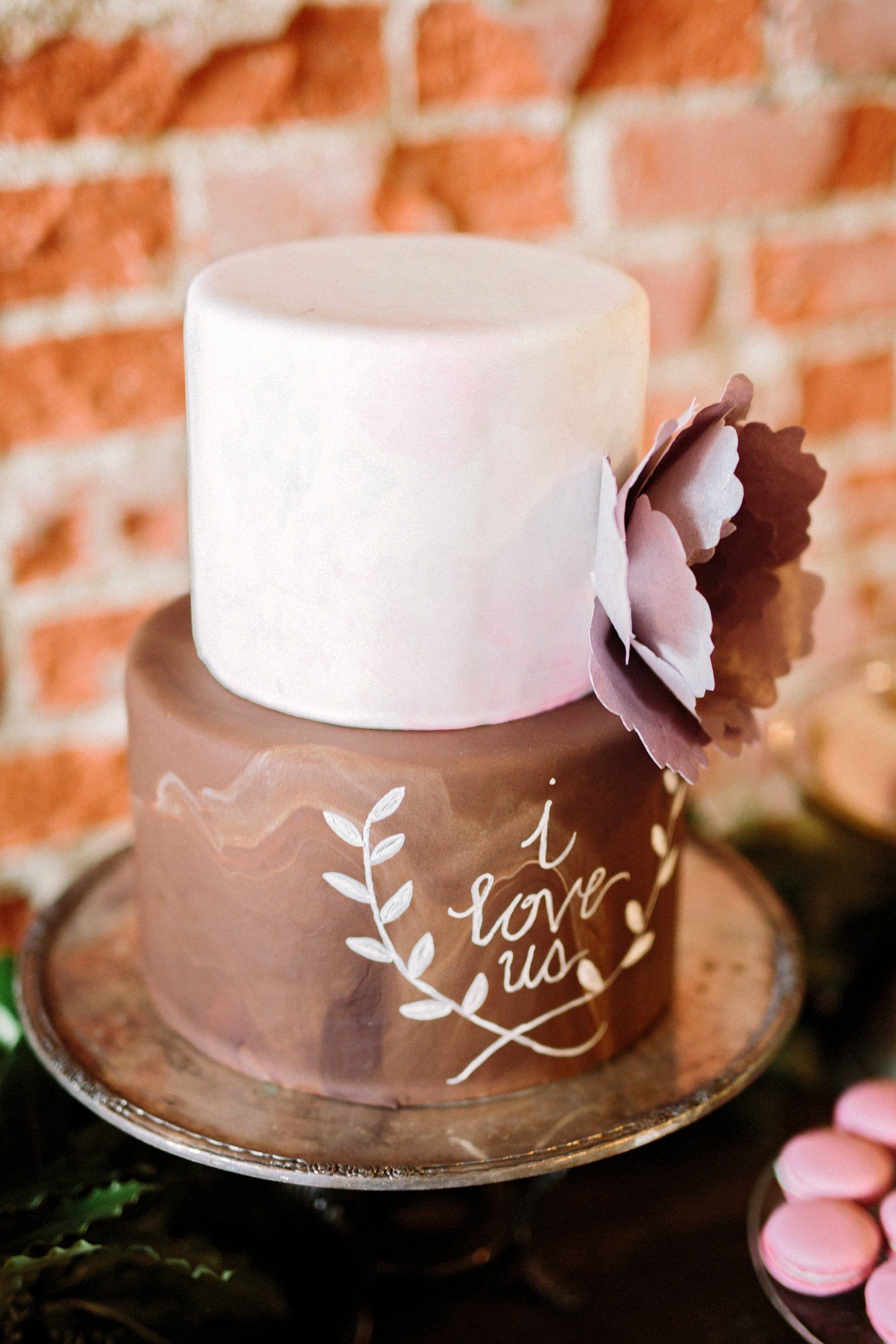 simple two-tiered cake with writing