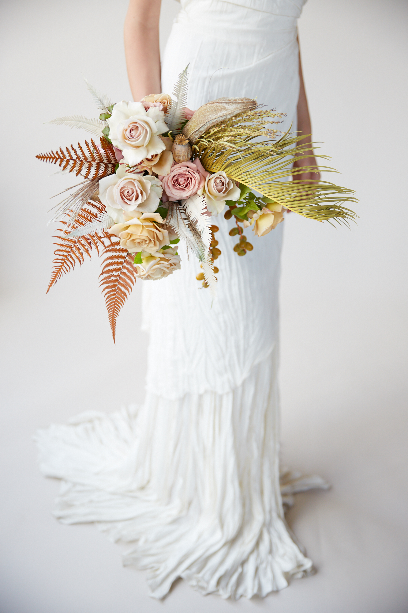 modern wedding bouquet leaves and grass
