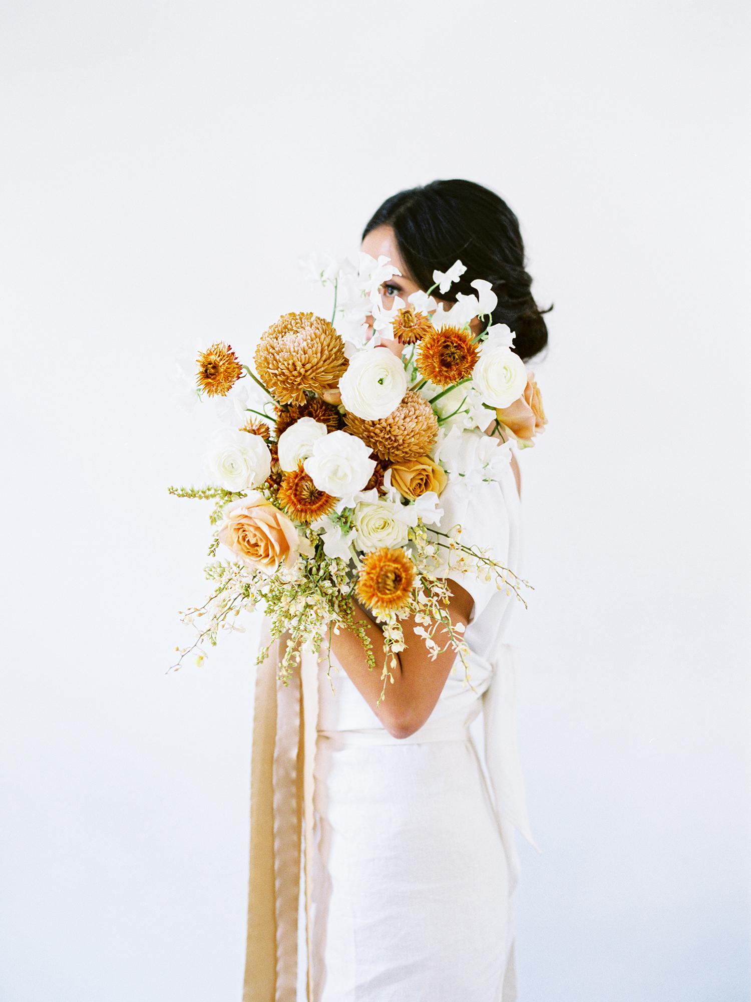 modern wedding bouquet burnt orange mums