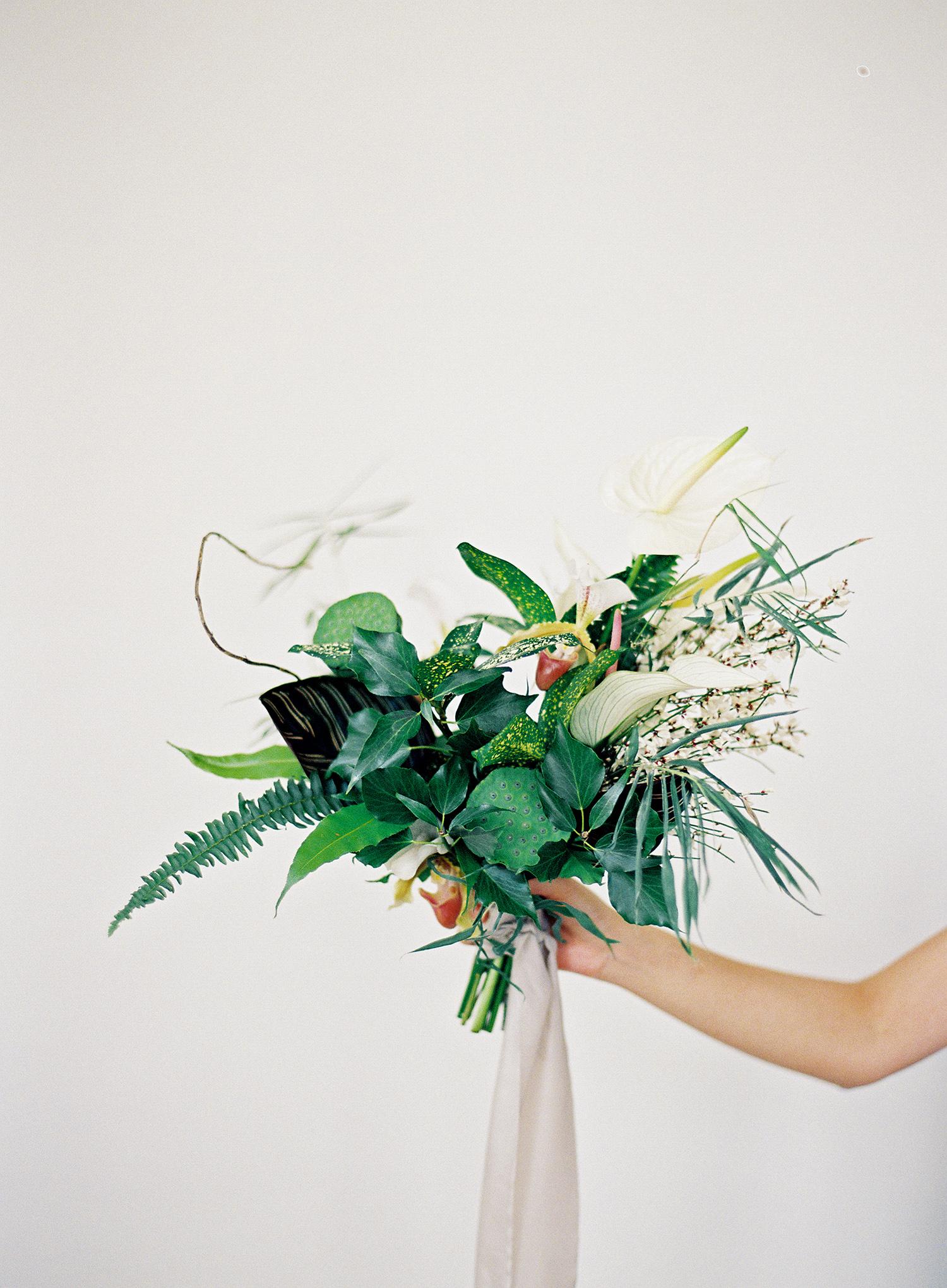 modern wedding bouquet tropical greenery