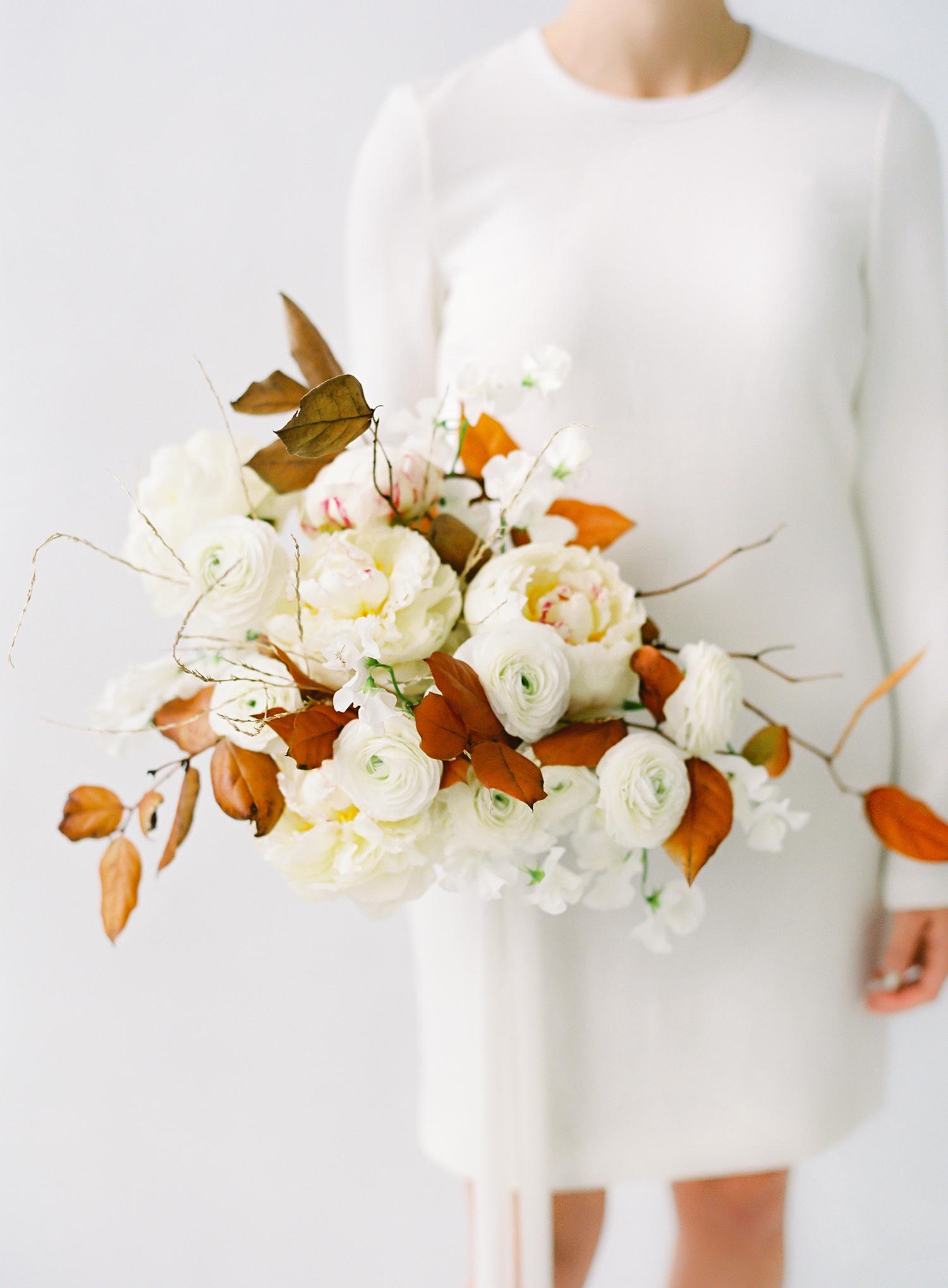 modern wedding bouquet rust and cream winter flowers