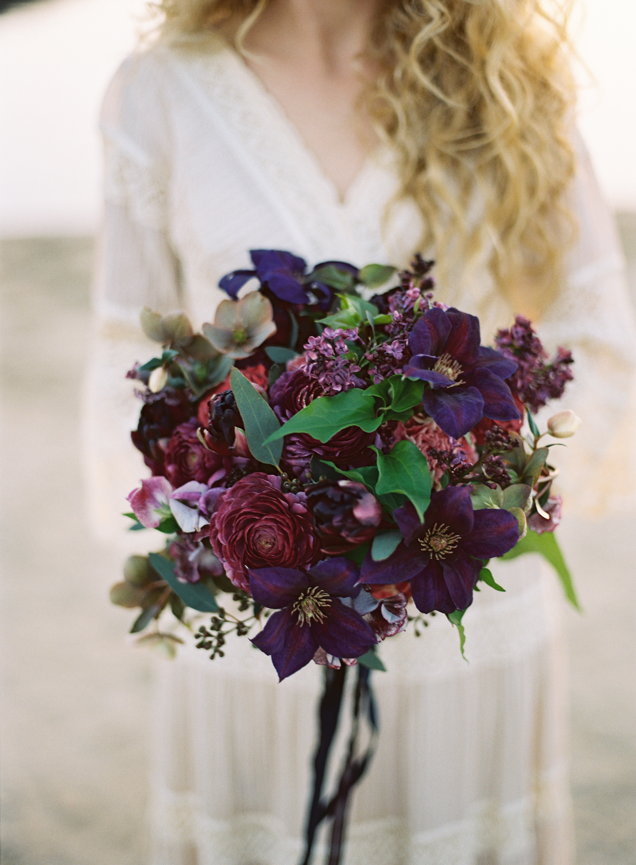 dark purple bouquet with greenery ranunculus