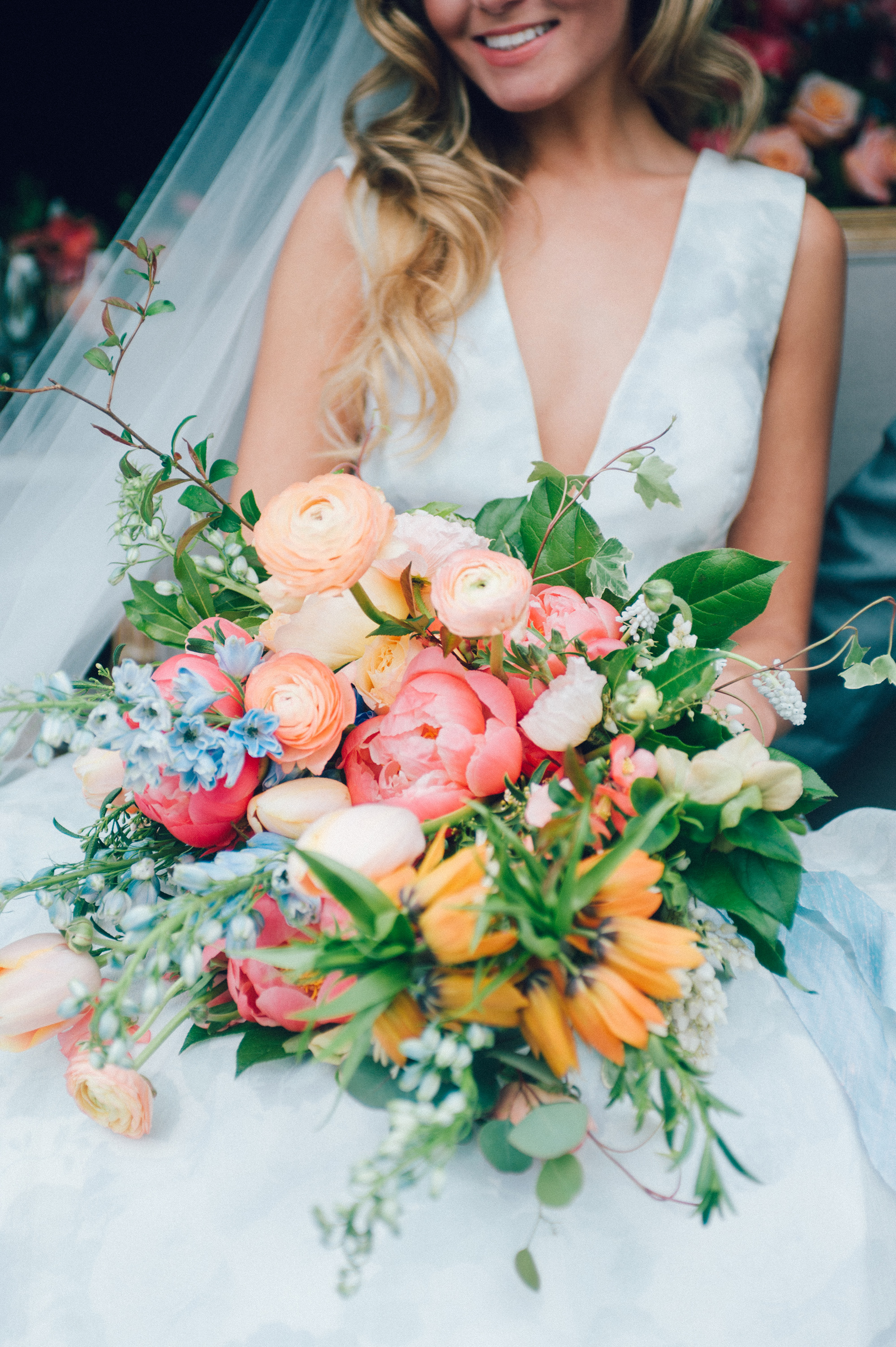 Loose, Romantic Pink Bouquet with Touches of Orange and Blue