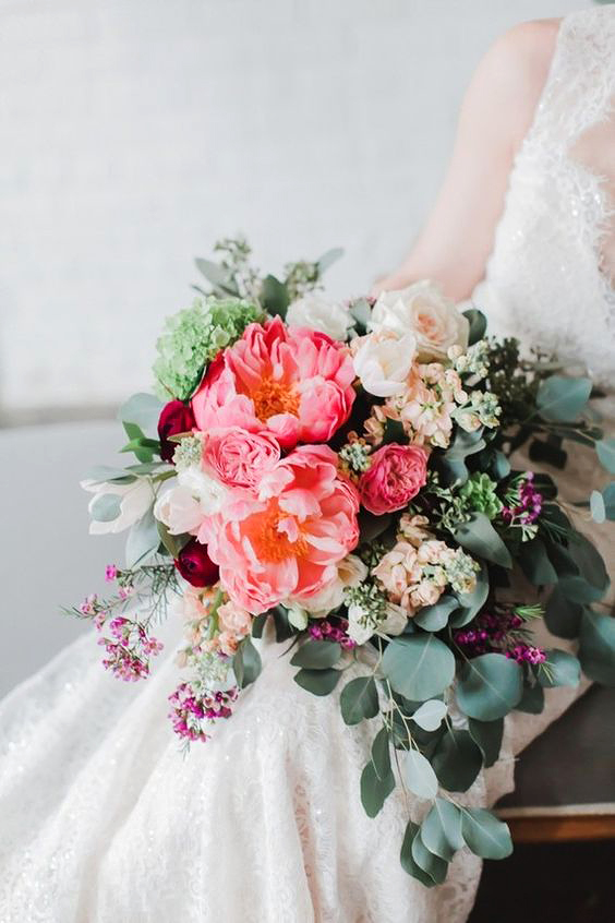 vibrant coral charm peony bouquet with muted greenery