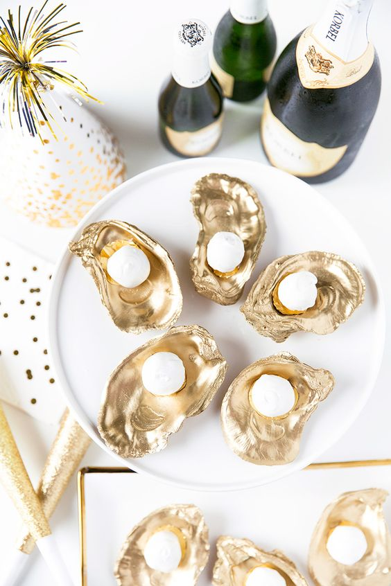 gold coated Oyster Truffles with champagne bottles