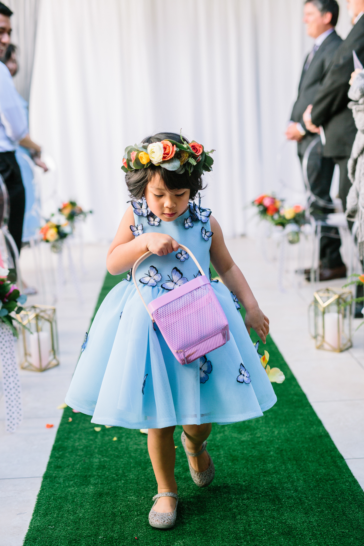 flower girl wearing blue dress with butterfly applique