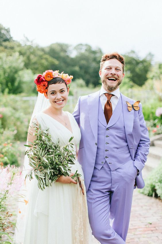 groom posing with bride wearing butterfly boutonniere