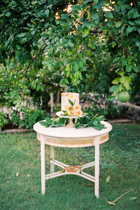 wedding cake outside with flowers