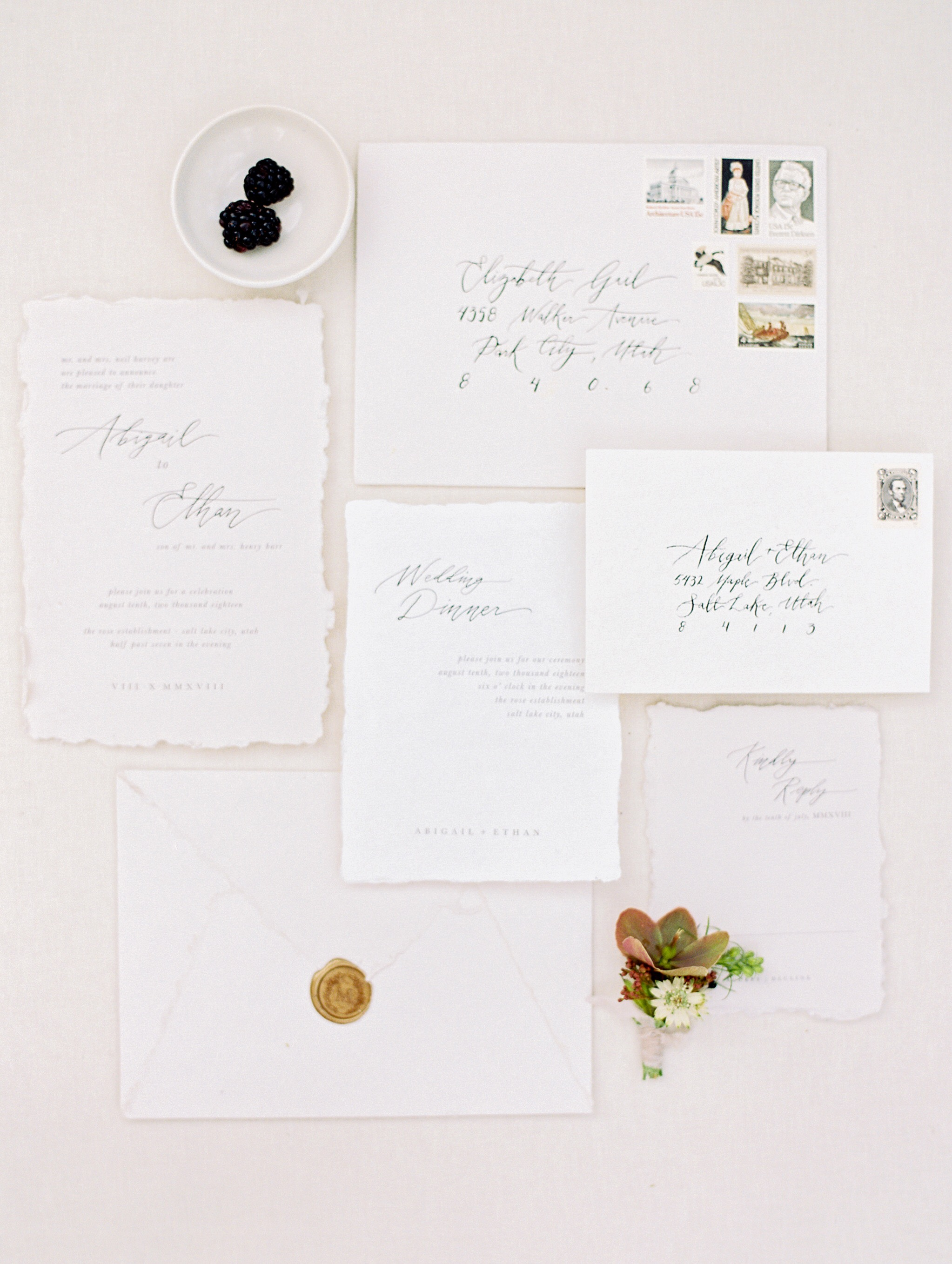all white vintage invite with black calligraphy
