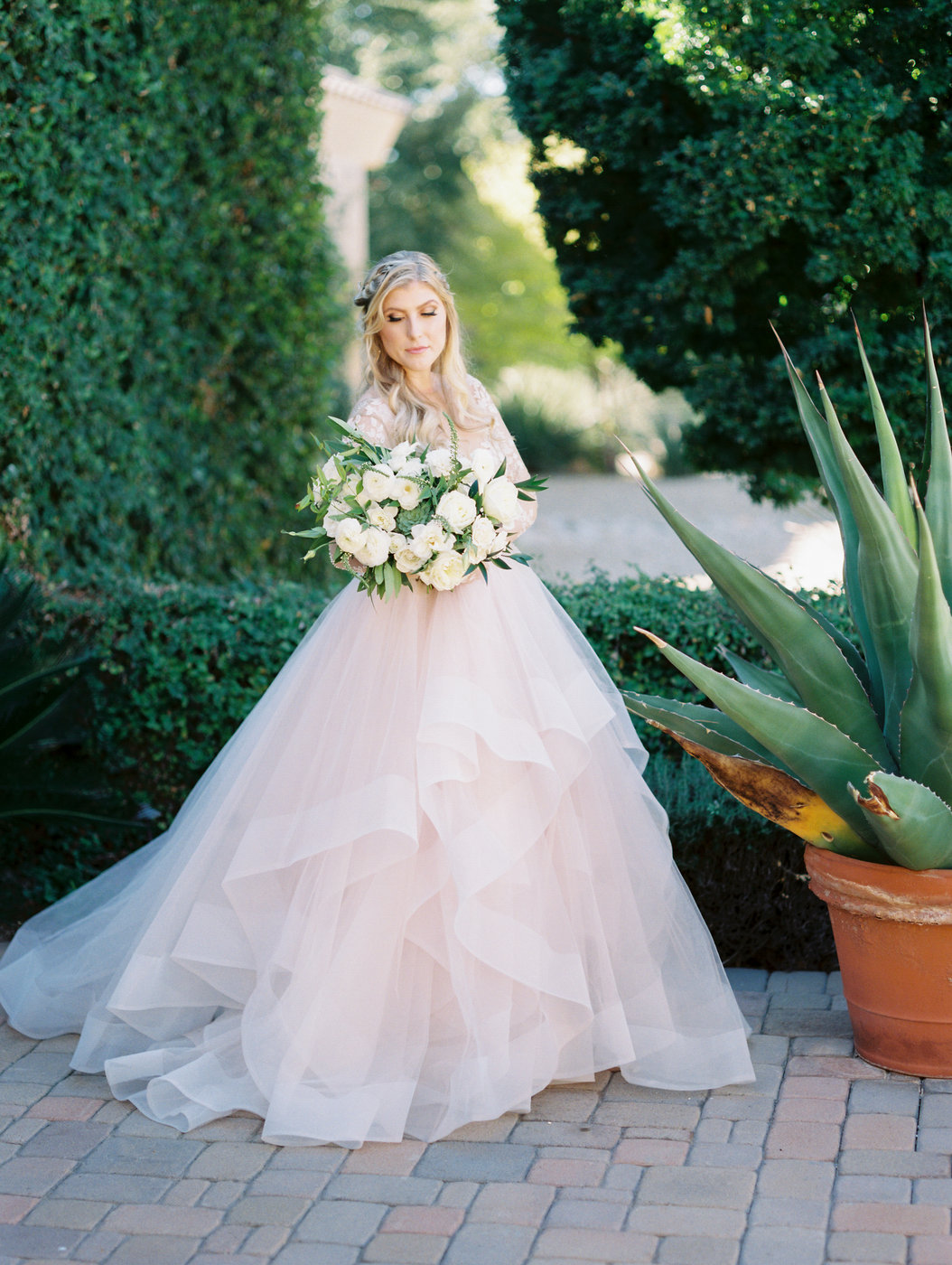 blush ball gown with ruffled skirt