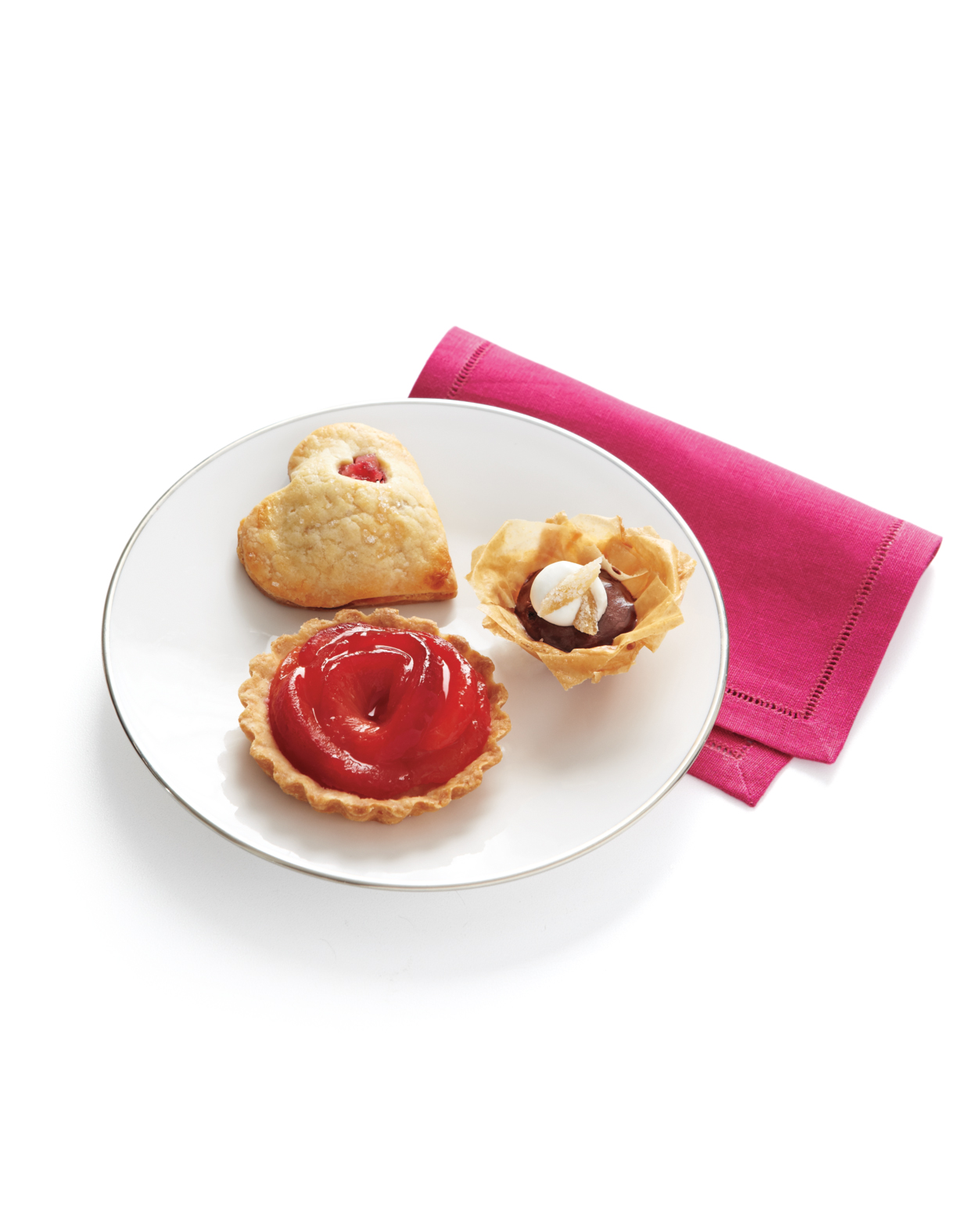 Red-Wine Poached Plum Tartlets