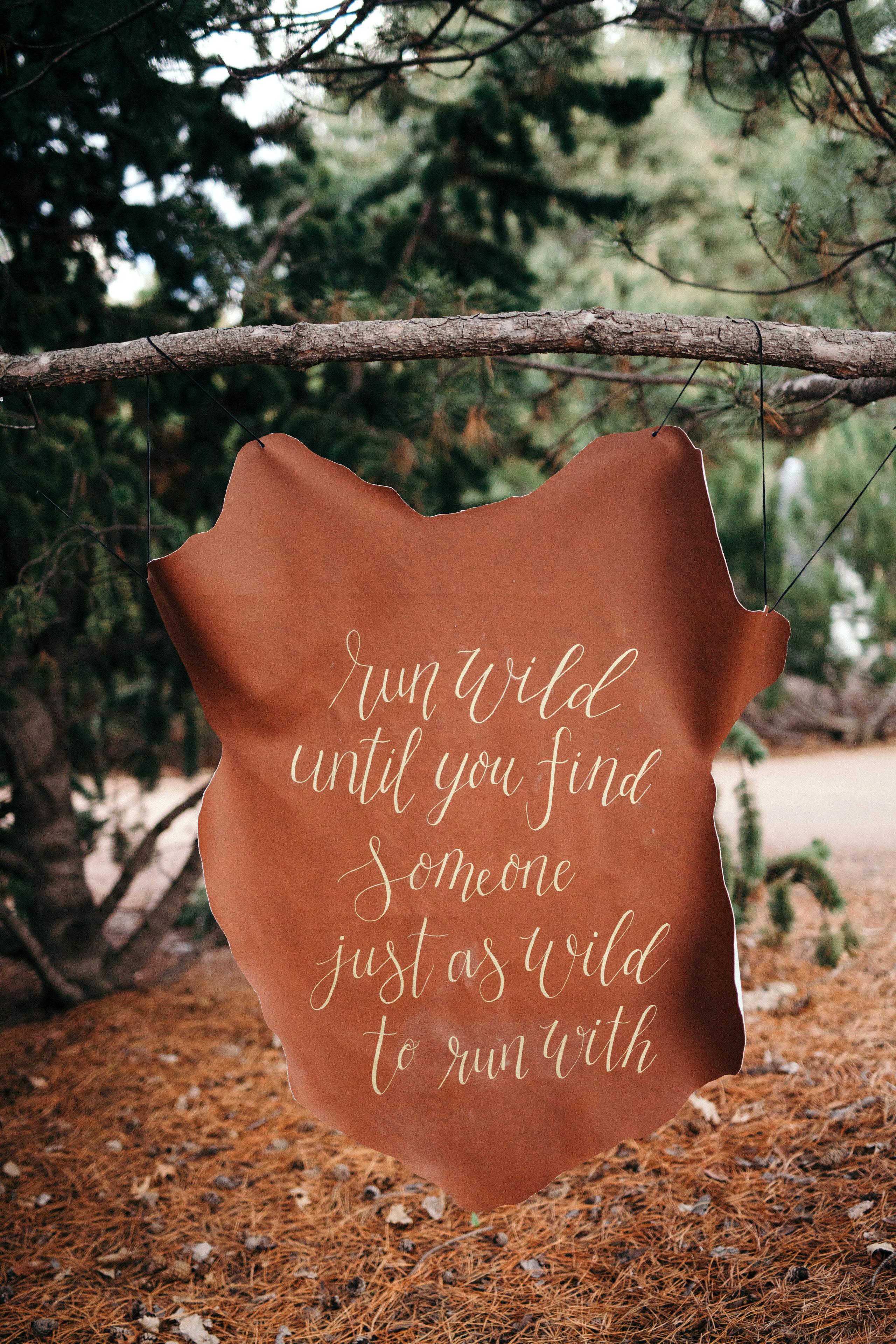 run wild leather wedding sign