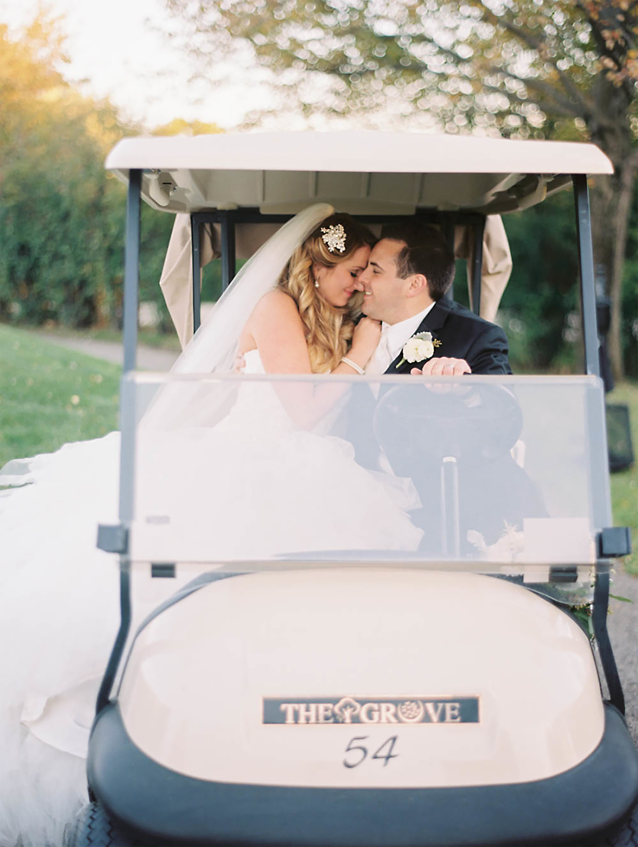 married couple in golf cart