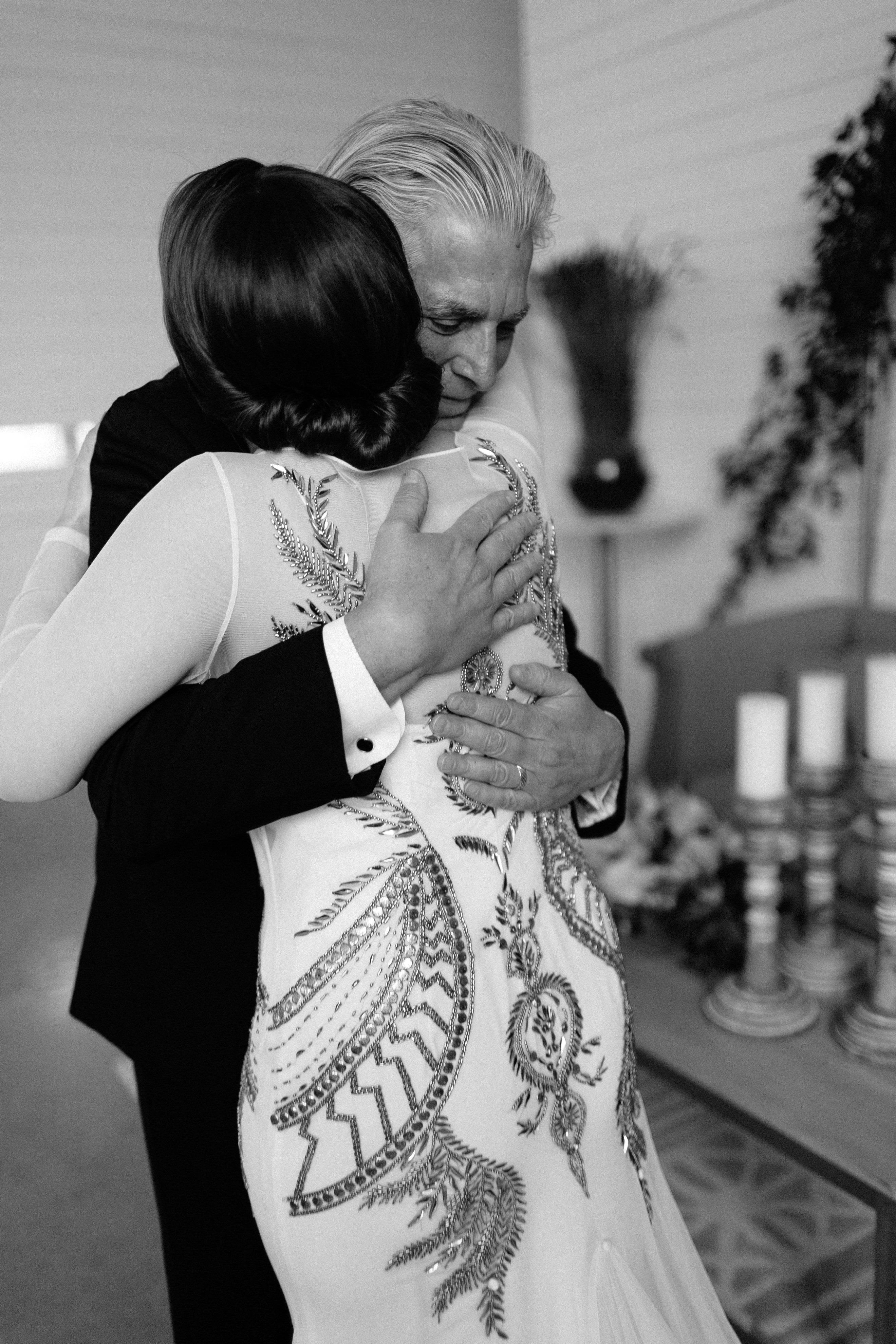 wedding father and daughter hug