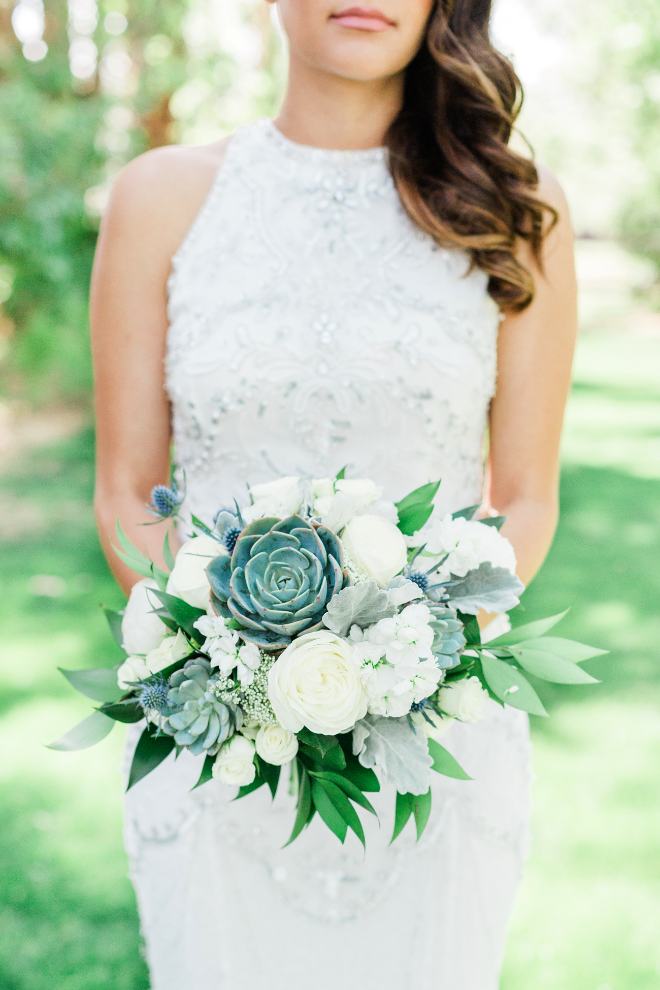 white floral and green succulent wedding bouquet