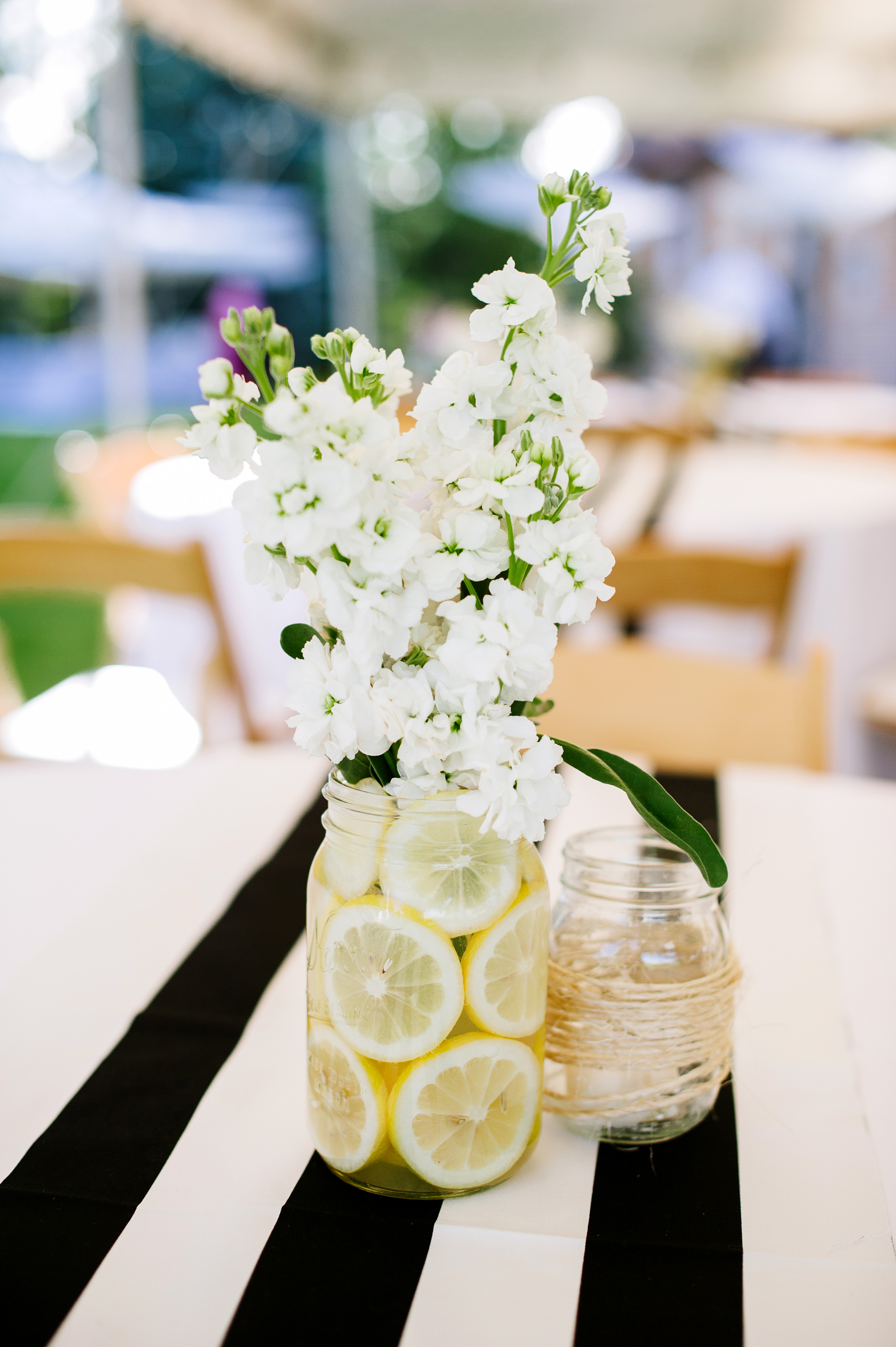 mason jar floral centerpiece with lemons