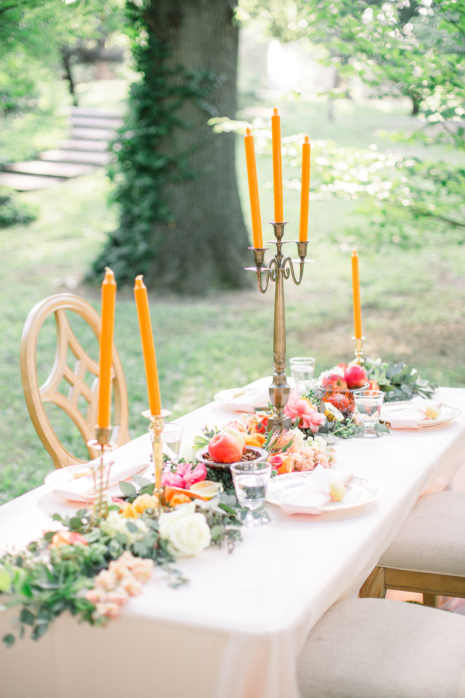 neon candle centerpieces on long table