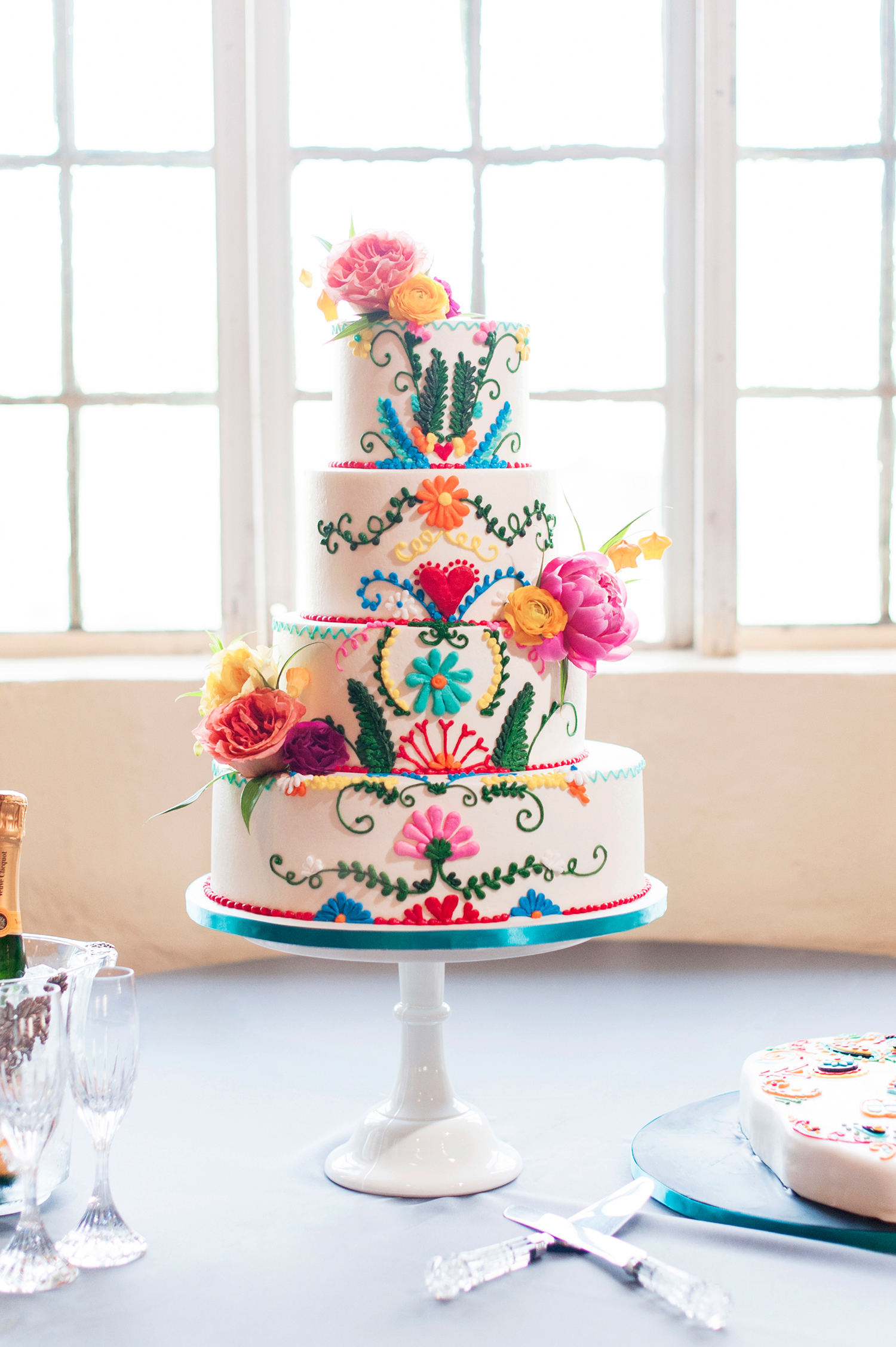 neon wedding cake with colorful floral design