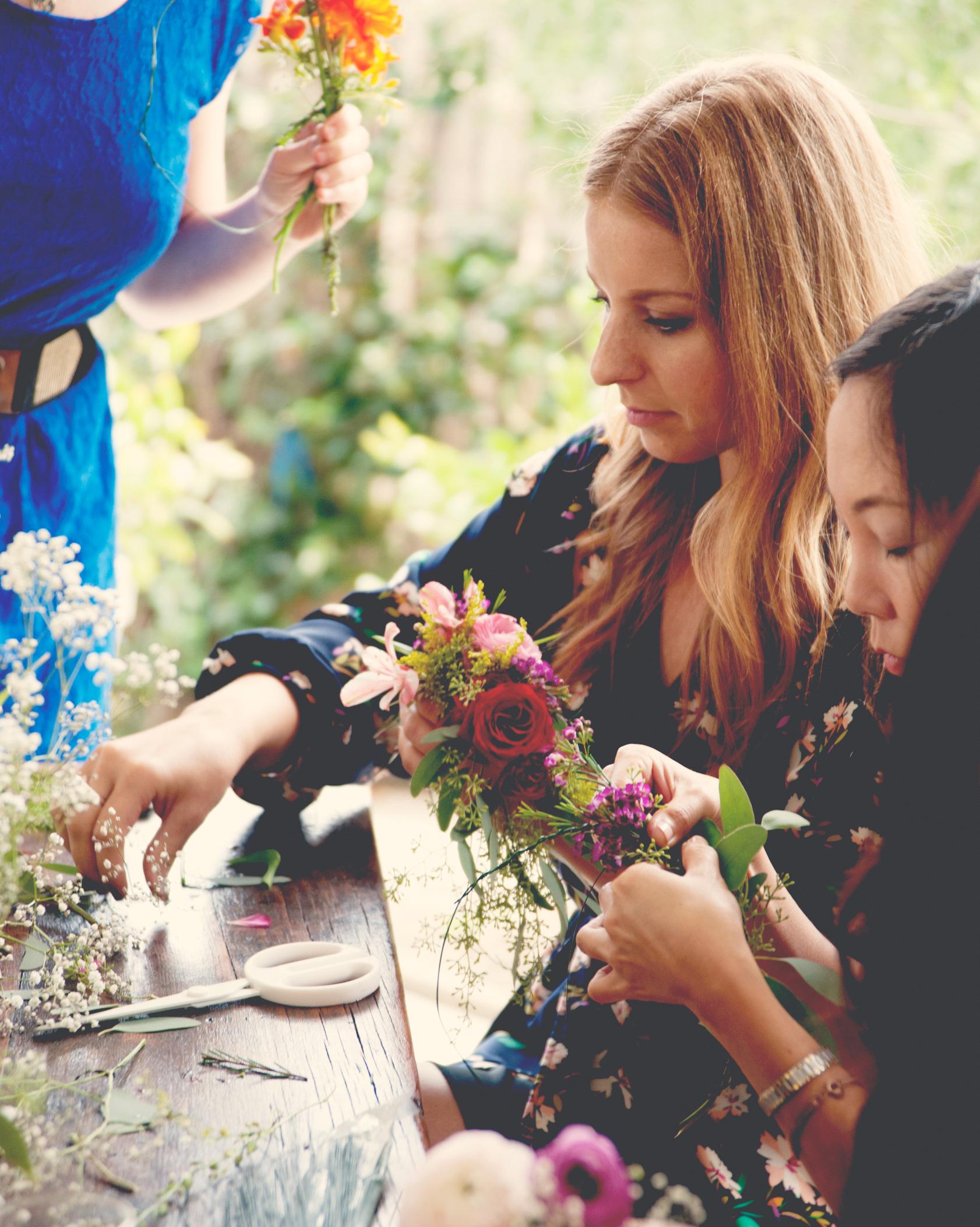 claire-thomas-bridal-shower-garden-friends-making-flower-craft-0814.jpg