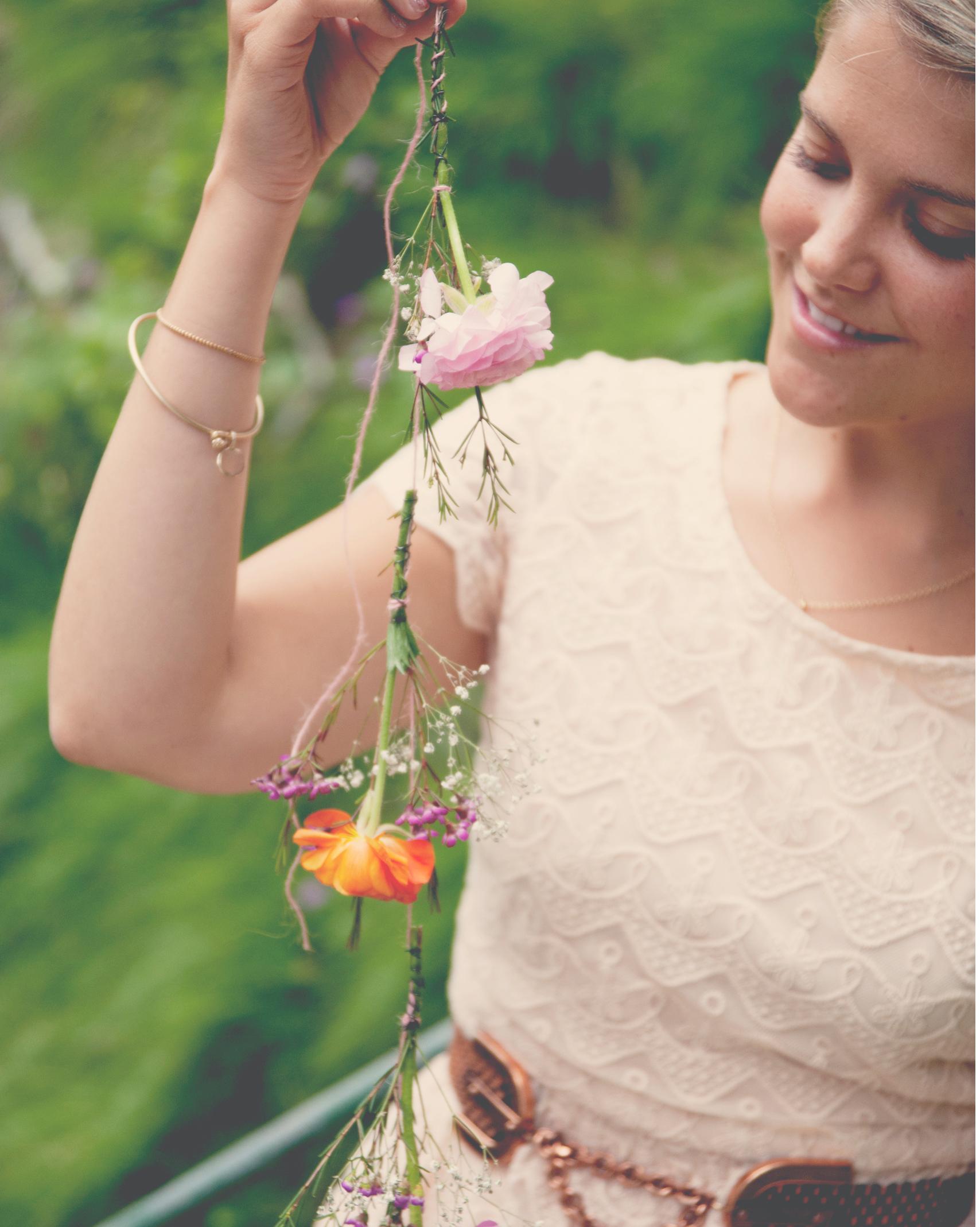 claire-thomas-bridal-shower-garden-girl-holding-flower-garland2-0814.jpg