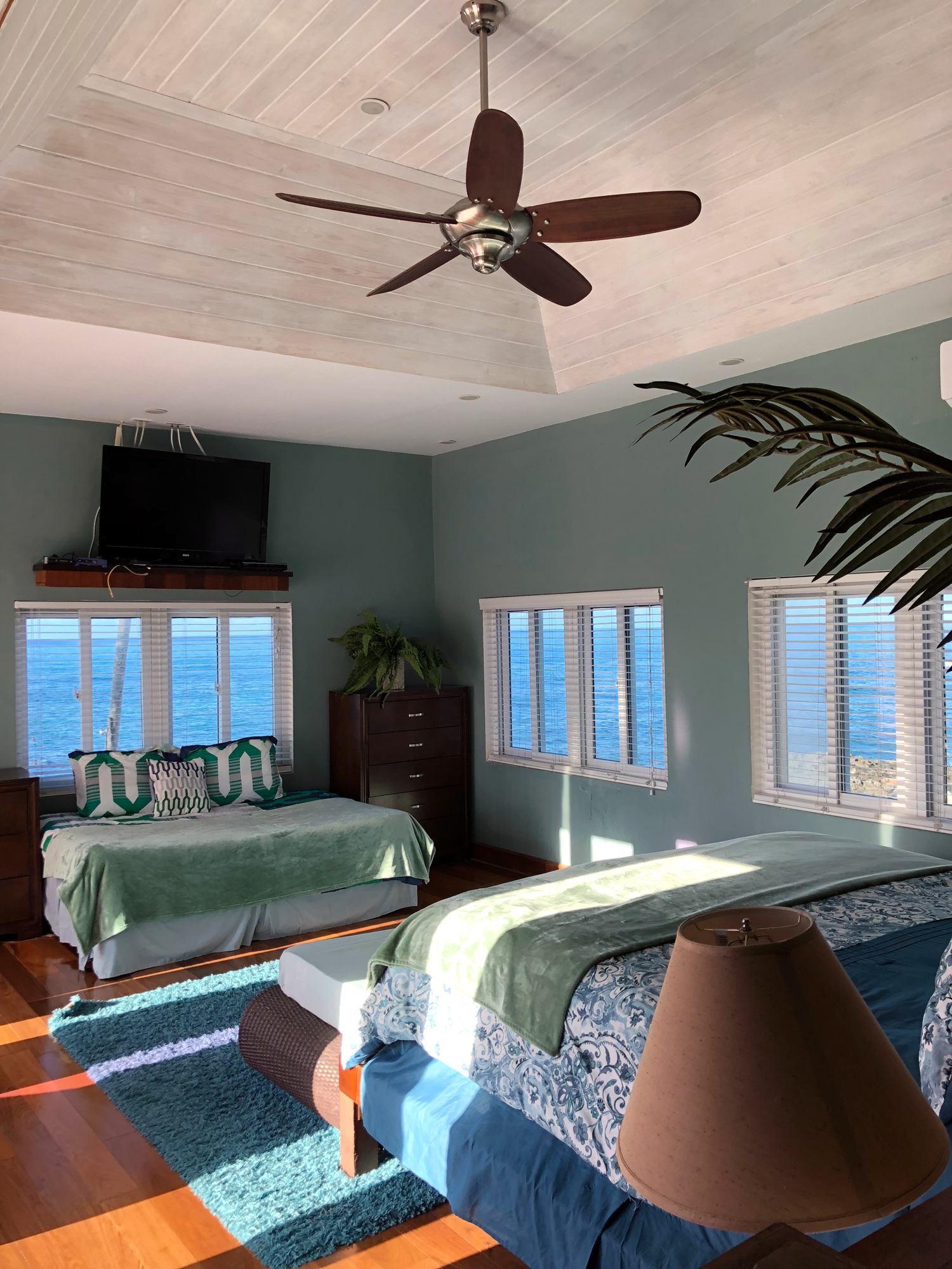 air bnb wedding venue green bedroom overlooking the ocean