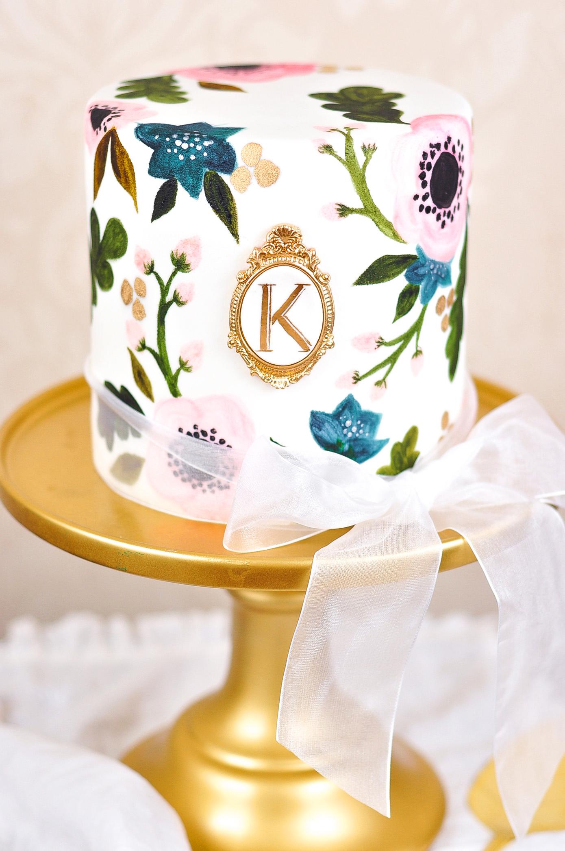 monogrammed bridal-shower-cake on pedestal