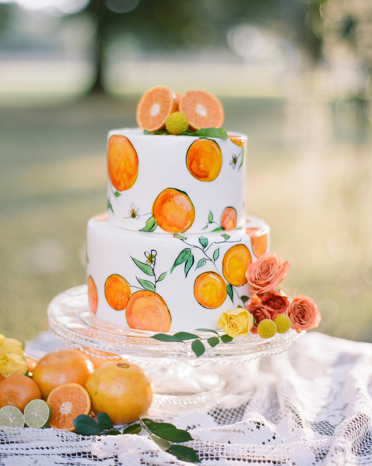 hand-painted oranges designed two tiered wedding cake