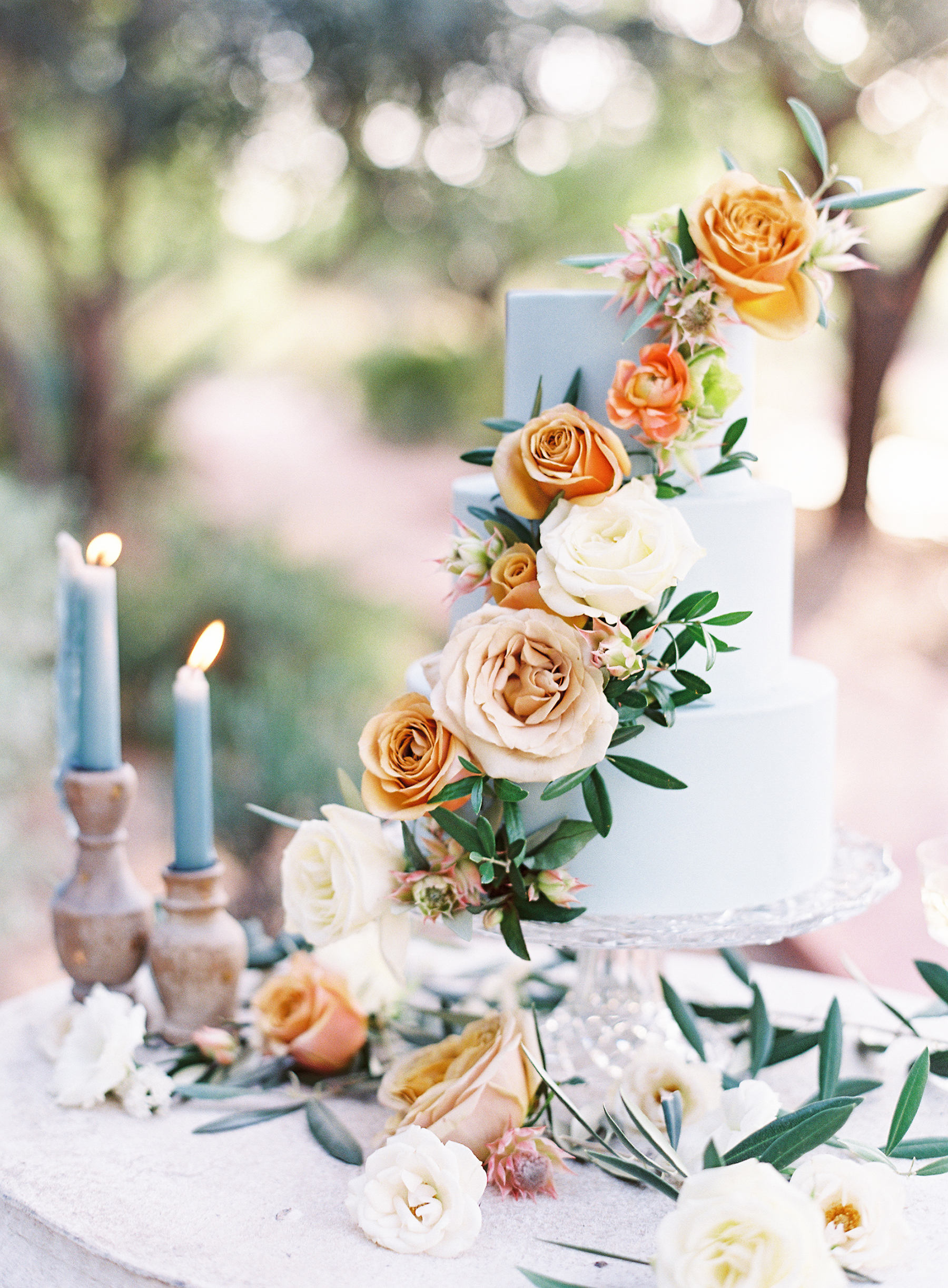 light blue wedding cake with orange flowers