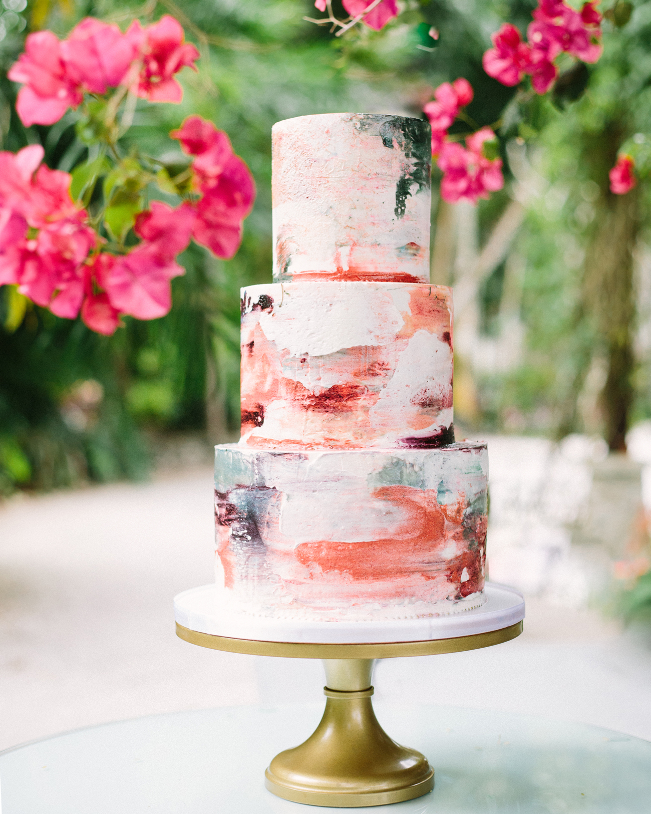 multi-hued brushstroke patterned three tiered cake