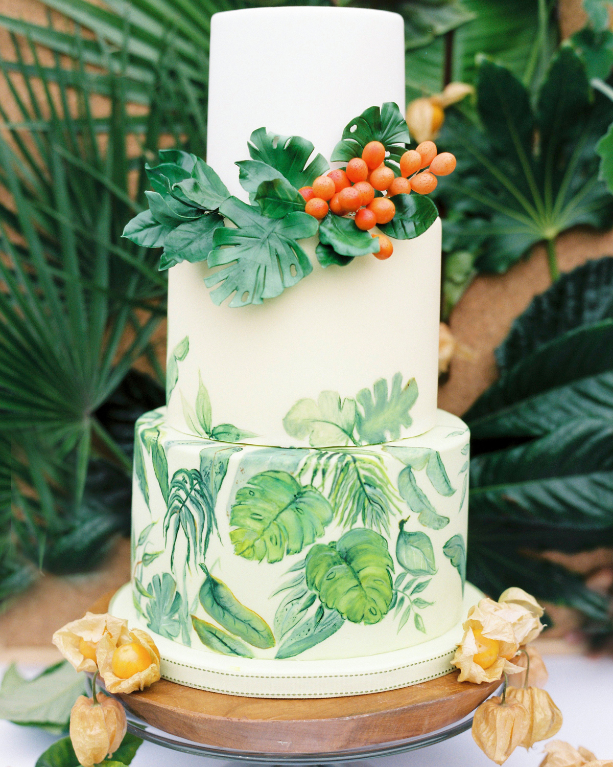 tropical foliage frosting design and cake decor three tiered wedding cake