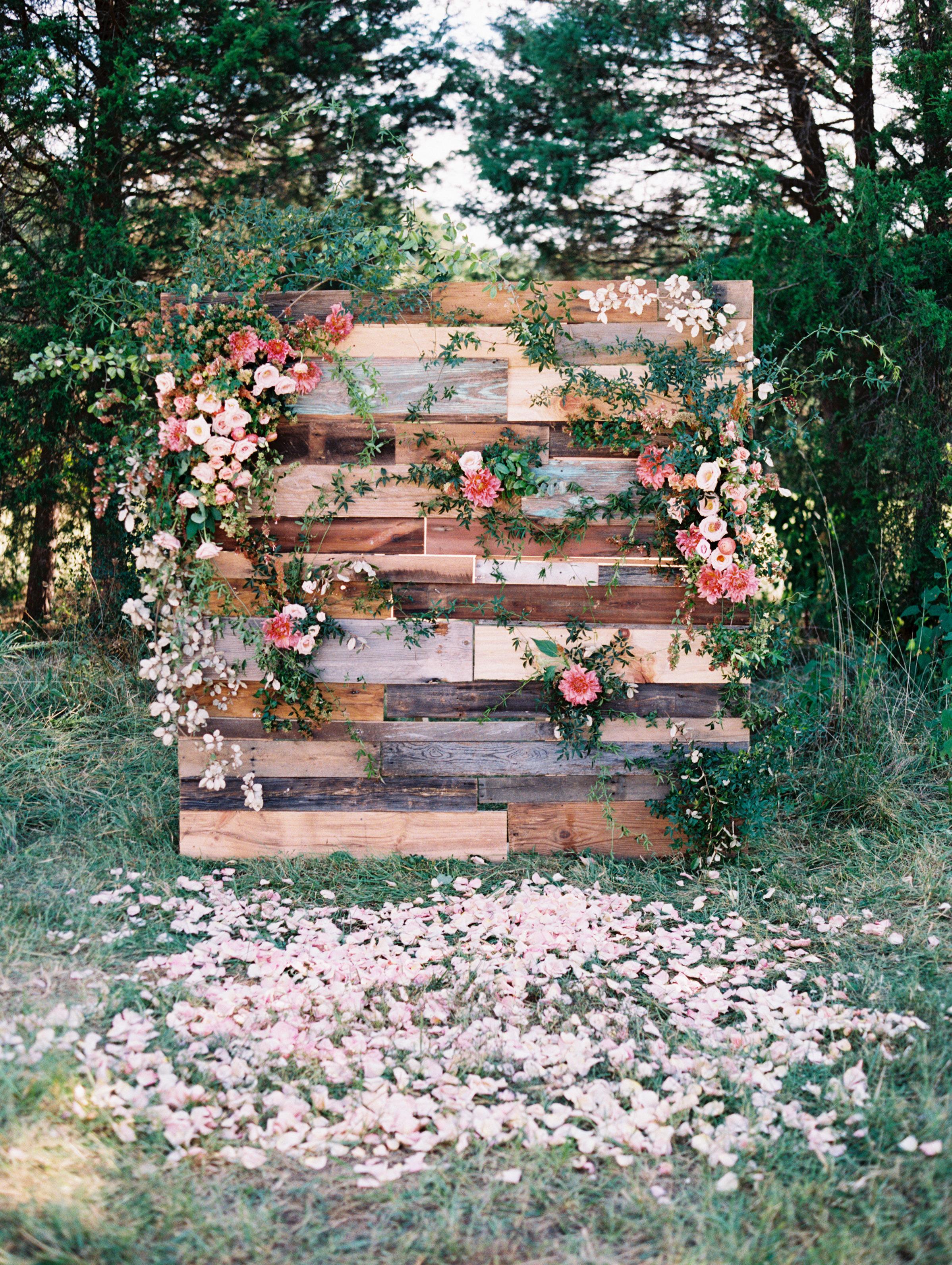 wedding backdrop free standing wood pallet pink blooms greenery