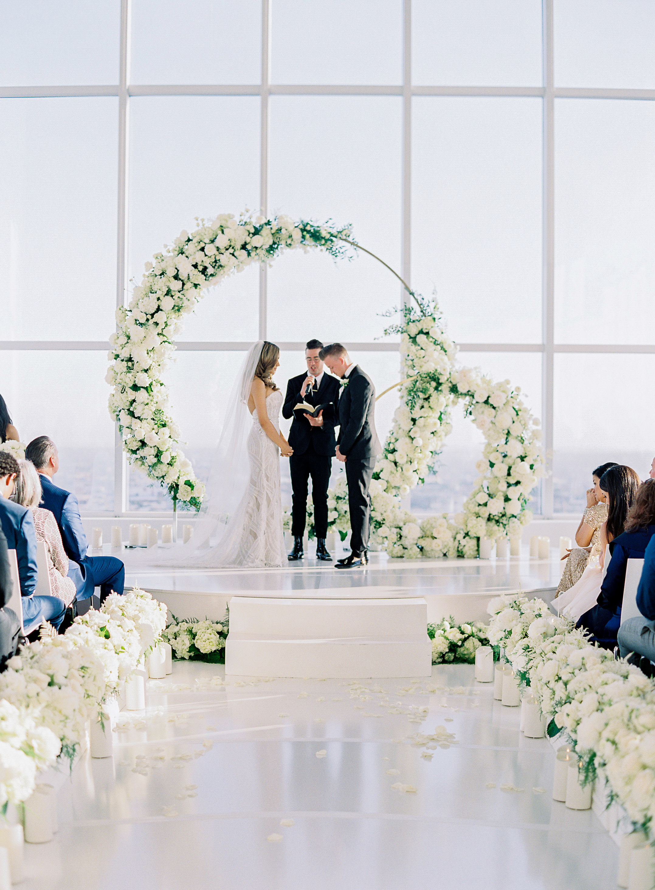 wedding backdrop white floral rings window wall