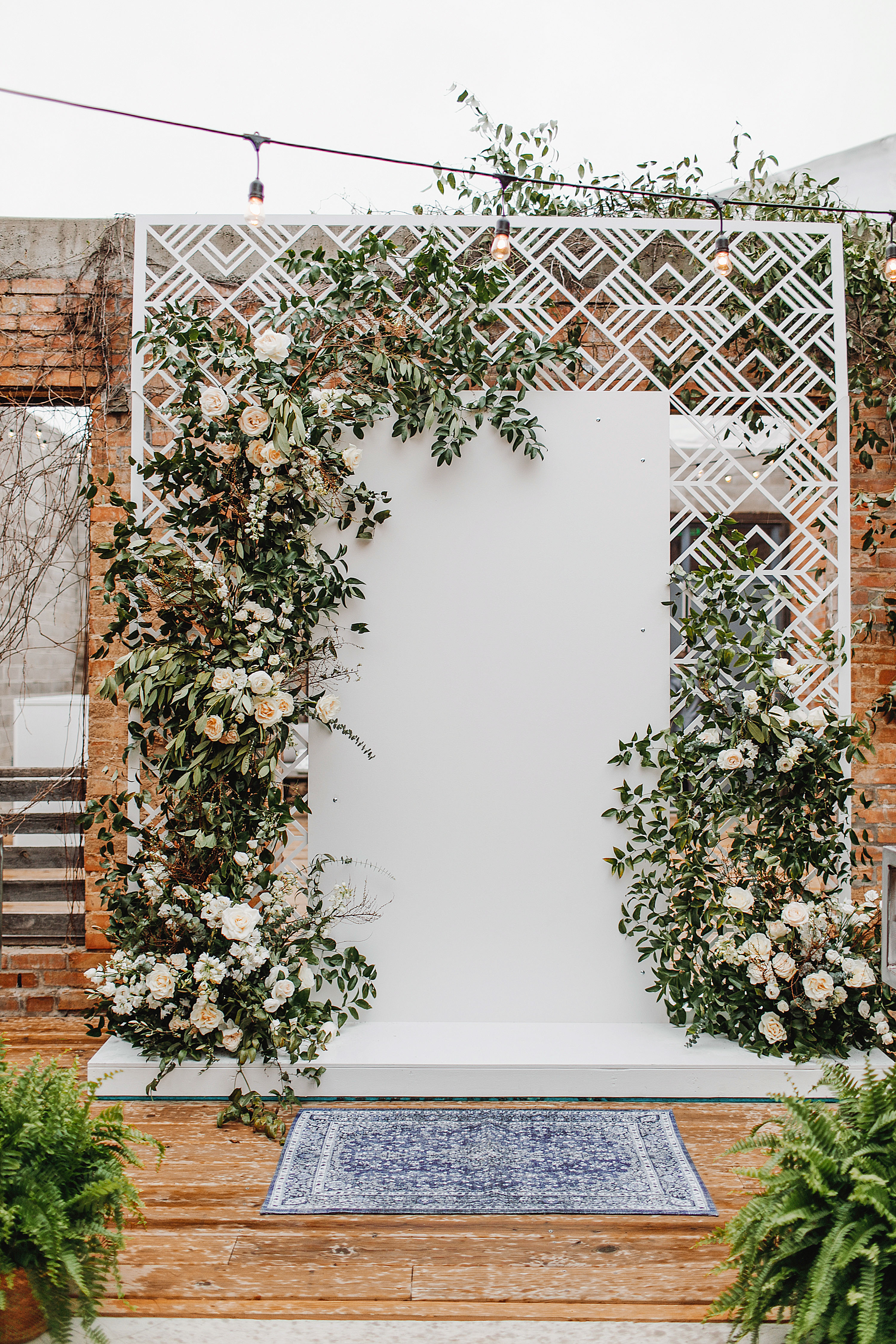 wedding ceremony backdrop geometric lattice floral pattern