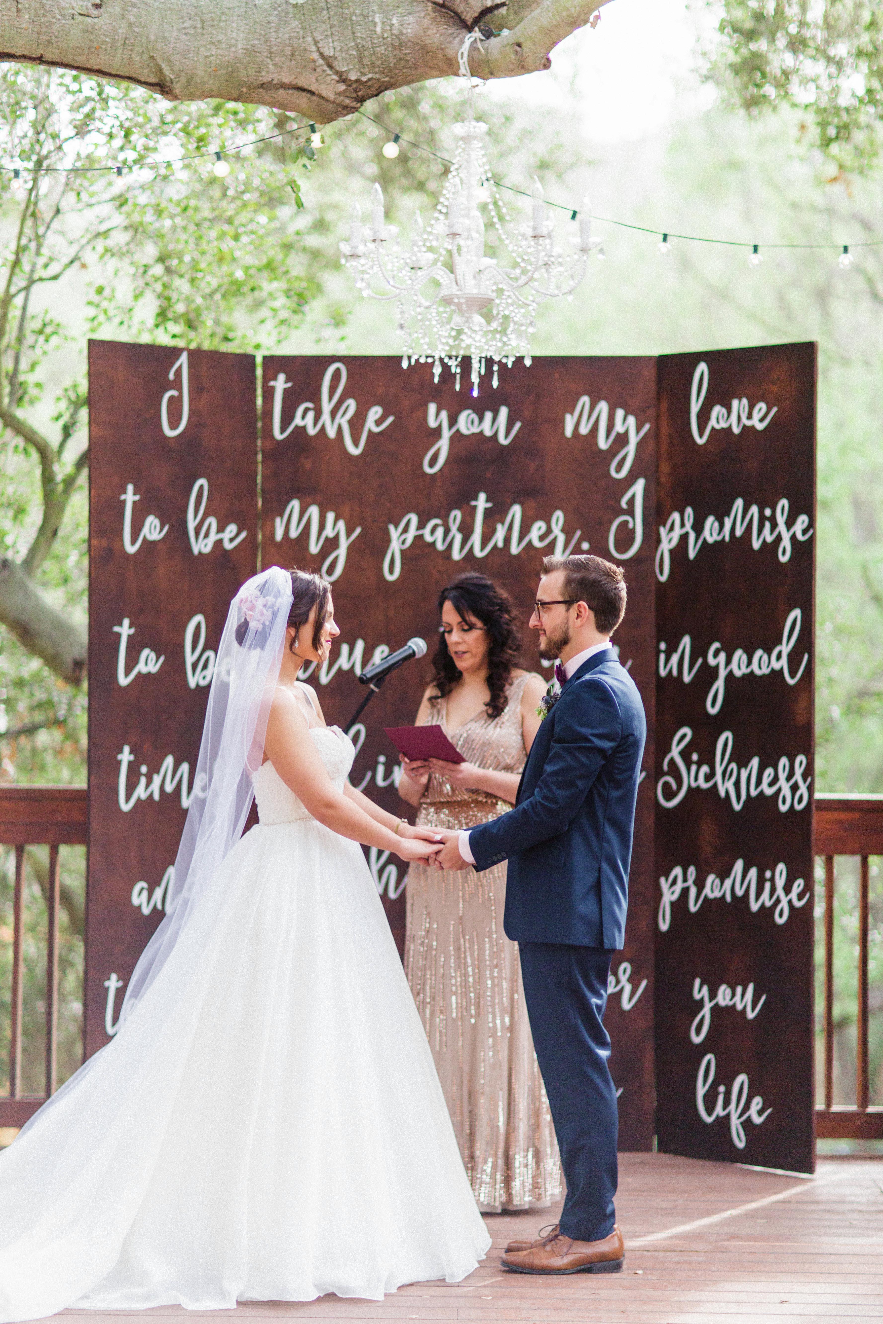 wedding ceremony backdrop white type on boards