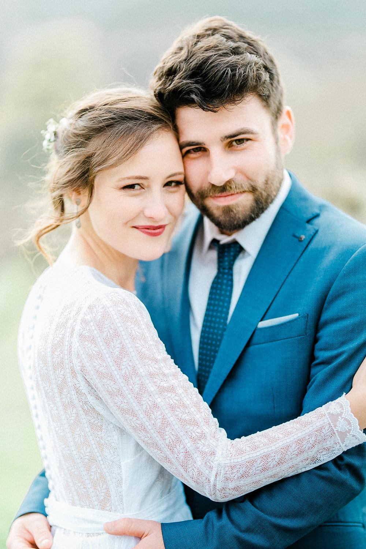 bold lipstick bride and groom embrace