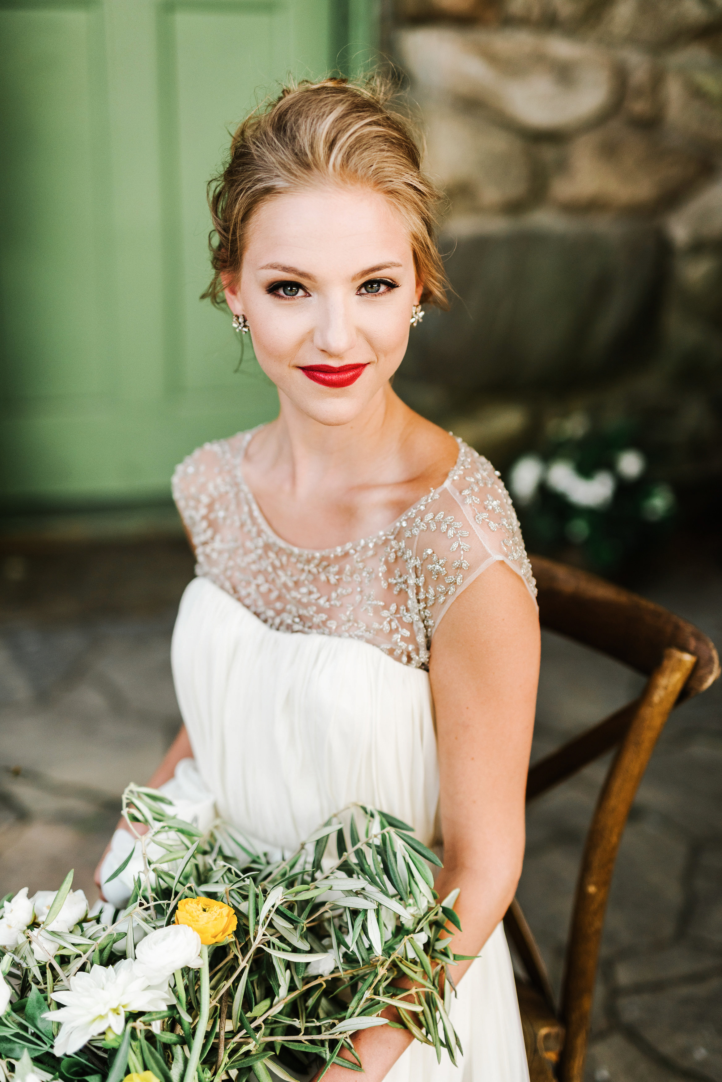 bold lipstick seated bride with bouquet