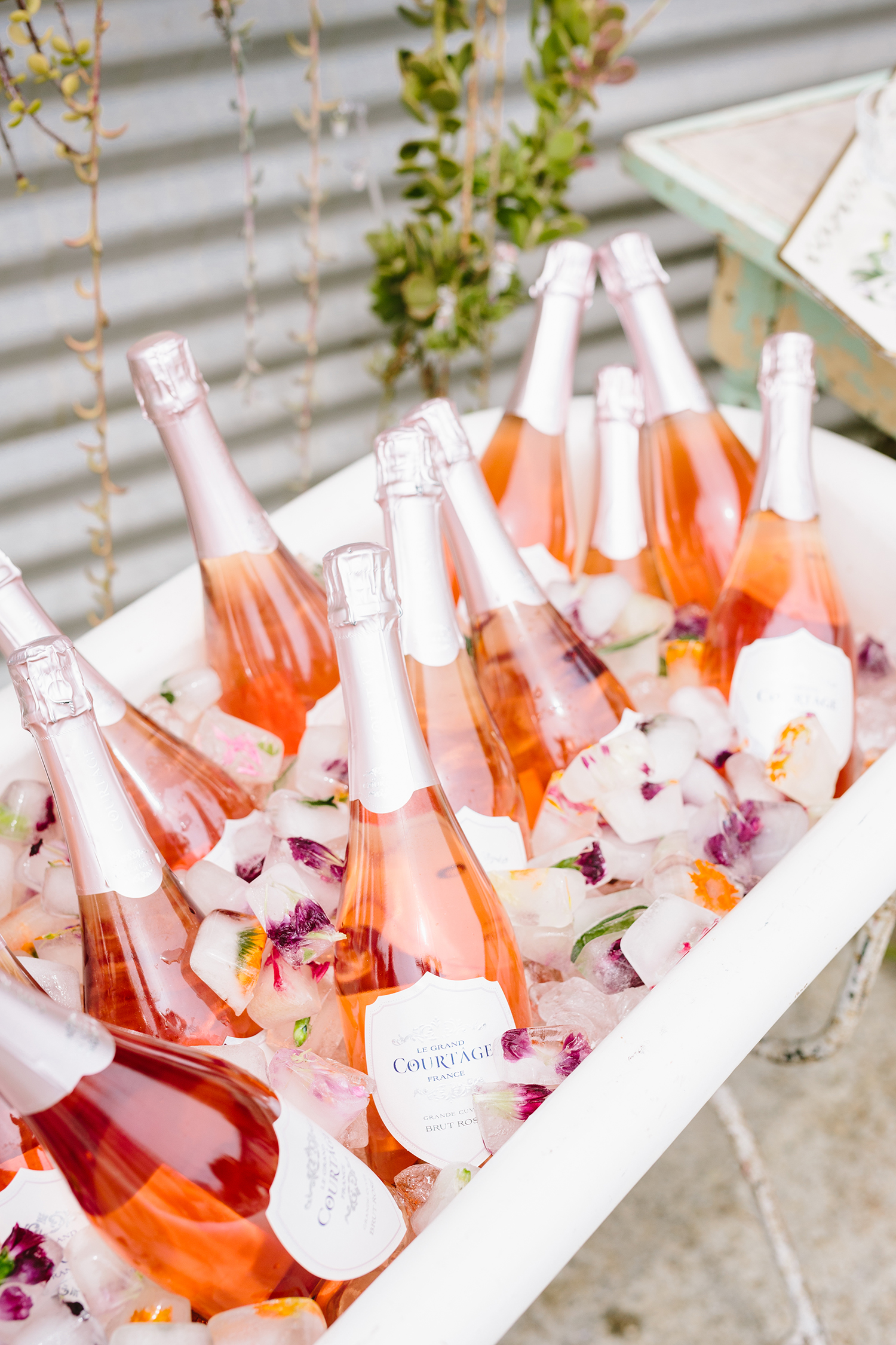 rose bottles in tub with floral ice cubes