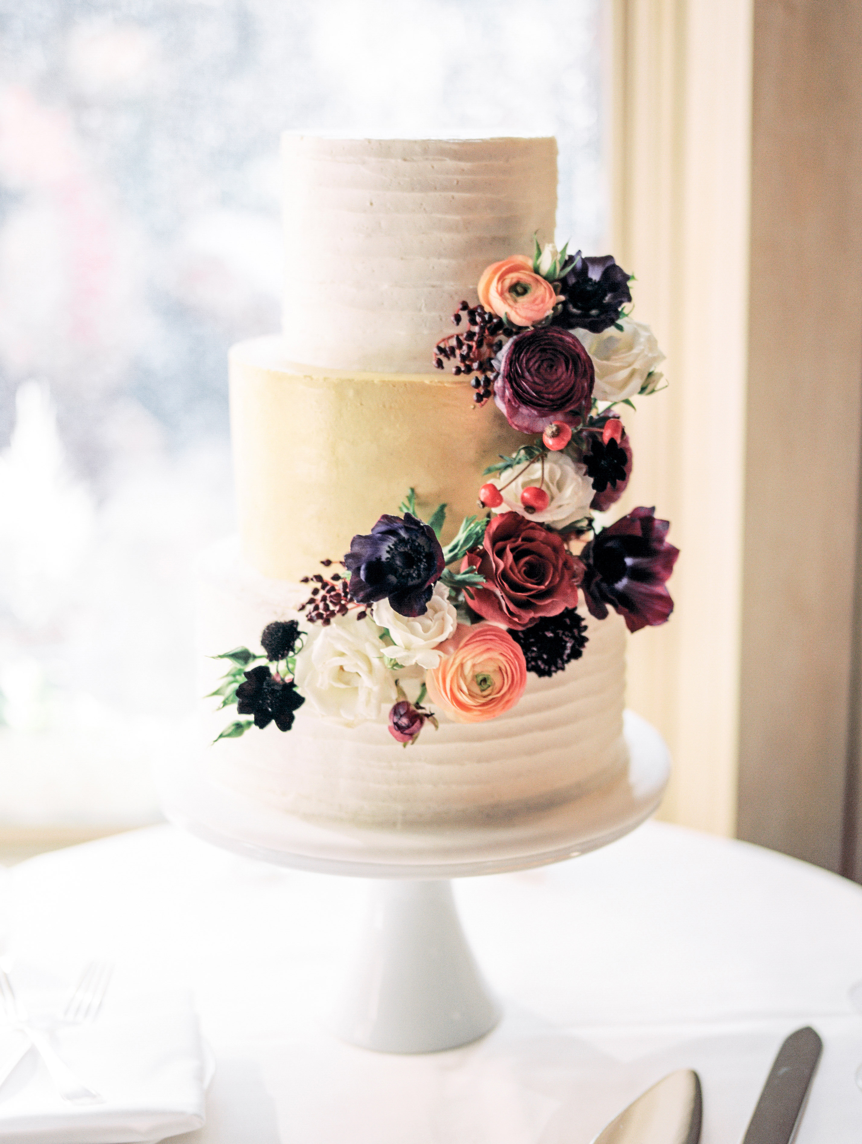 wedding cake with gold tier