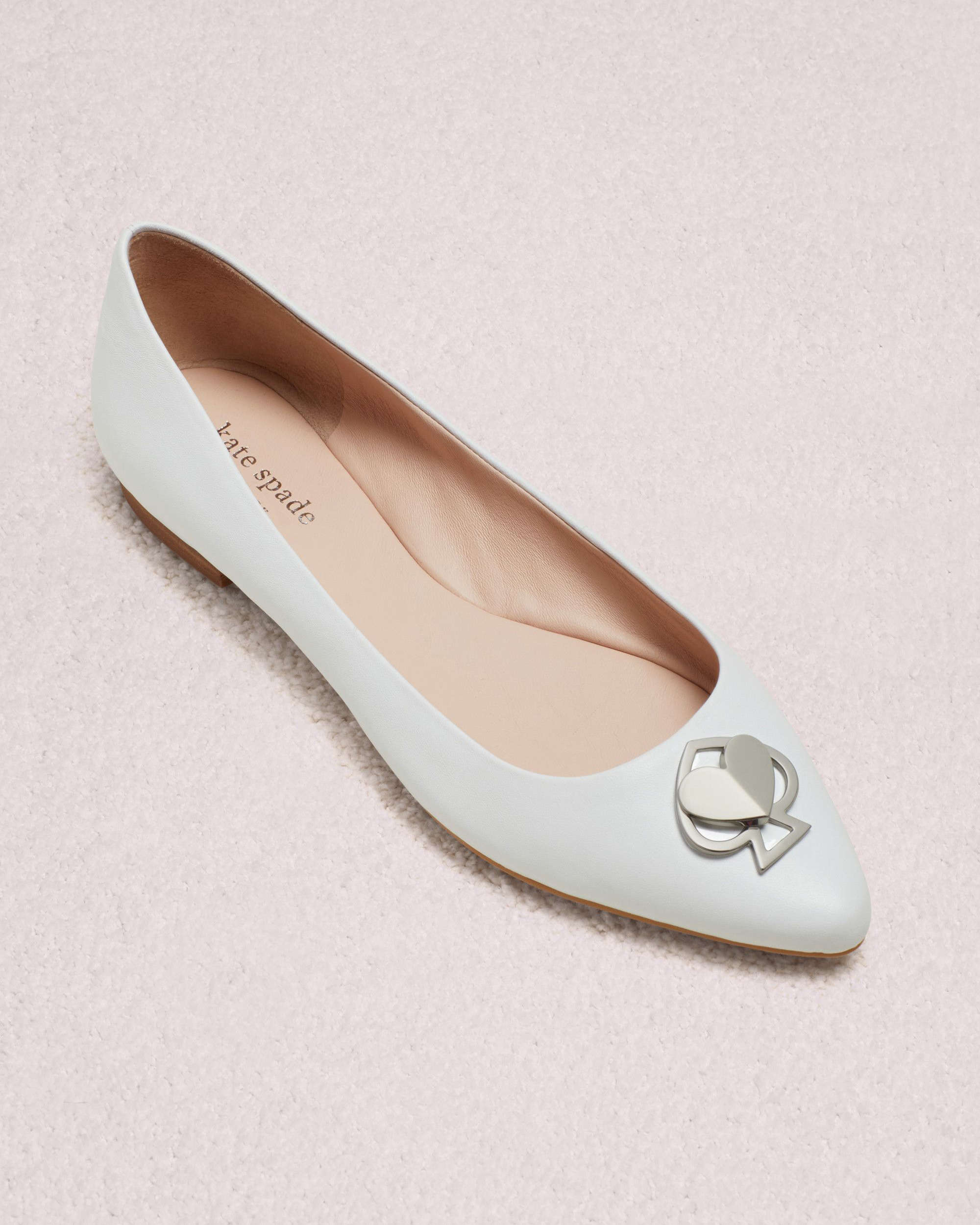 outdoor wedding shoes white flats with spade emblem
