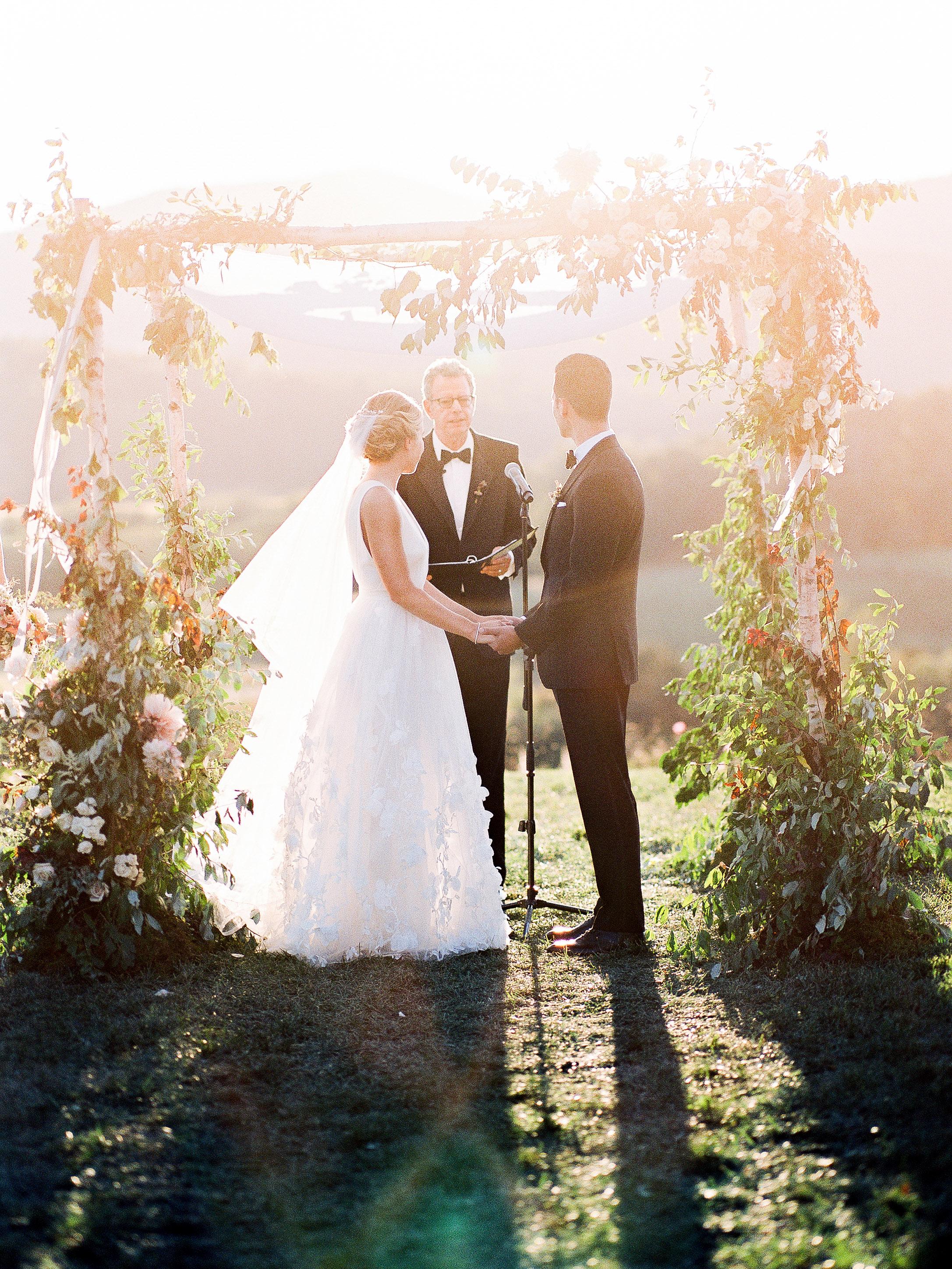 julianne aaron wedding ceremony couple arch