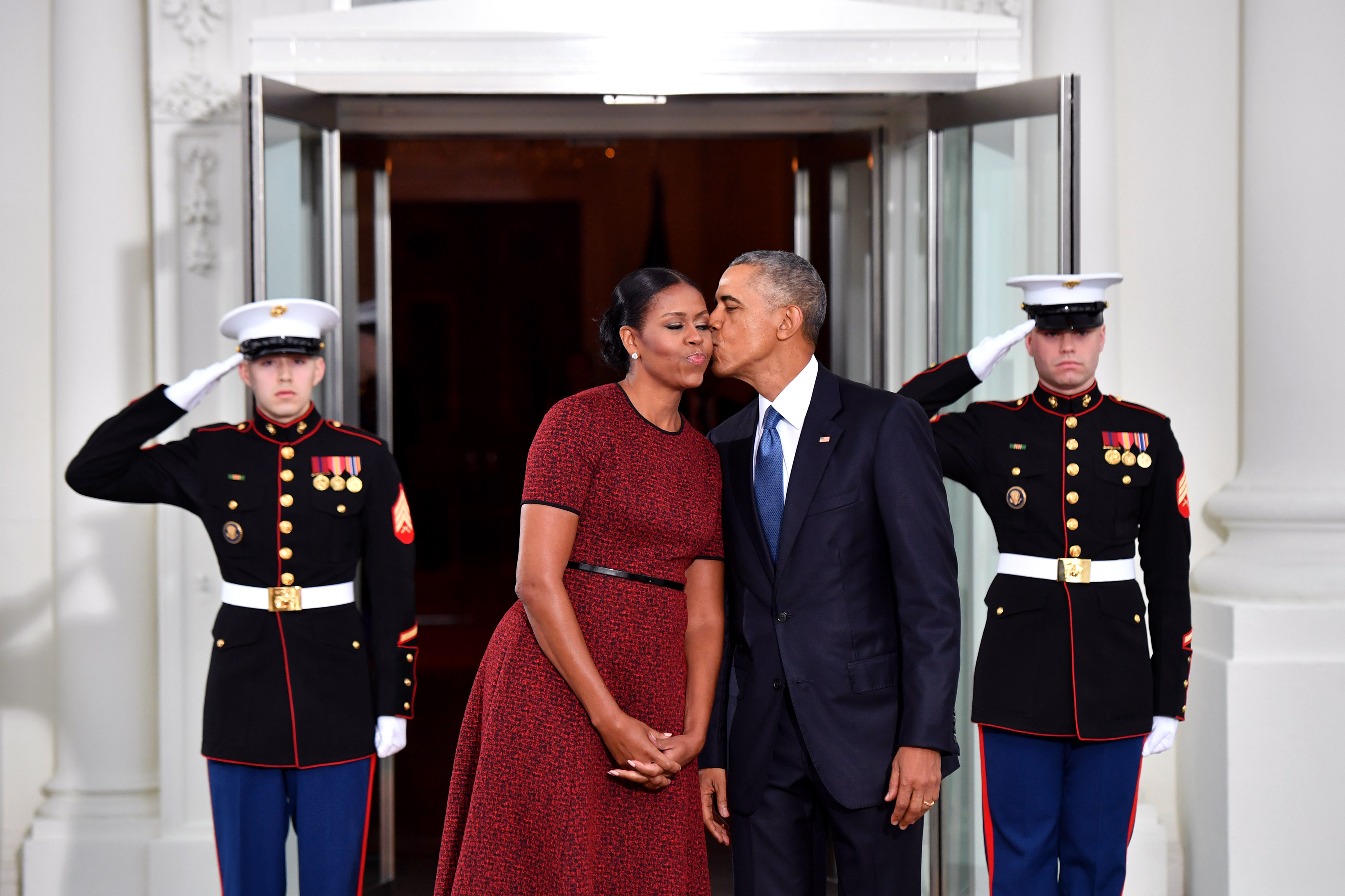 barack obama and michelle obama kiss on cheek