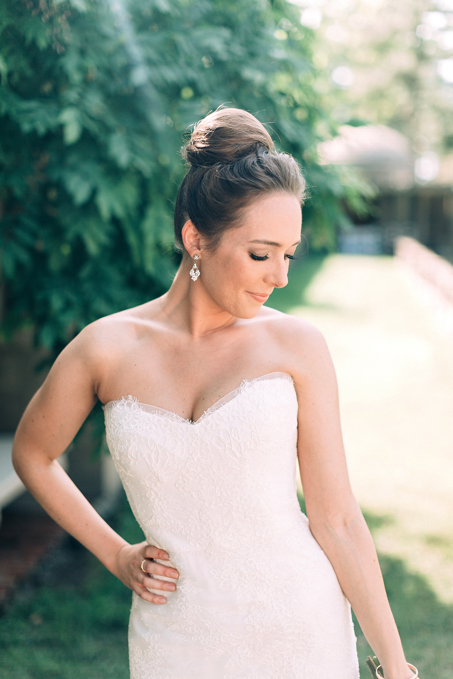 bride with strapless ball gown and high bun
